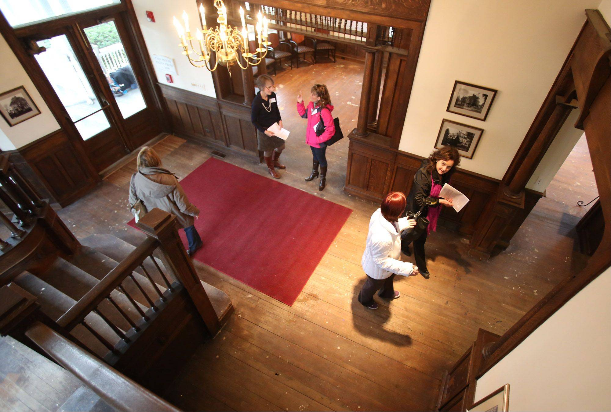 Volunteer guides show visitors around the first floor of the White House during open house tours Saturday at the Barrington estate set for a major renovation if a $5 million fundraising campaign is successful.