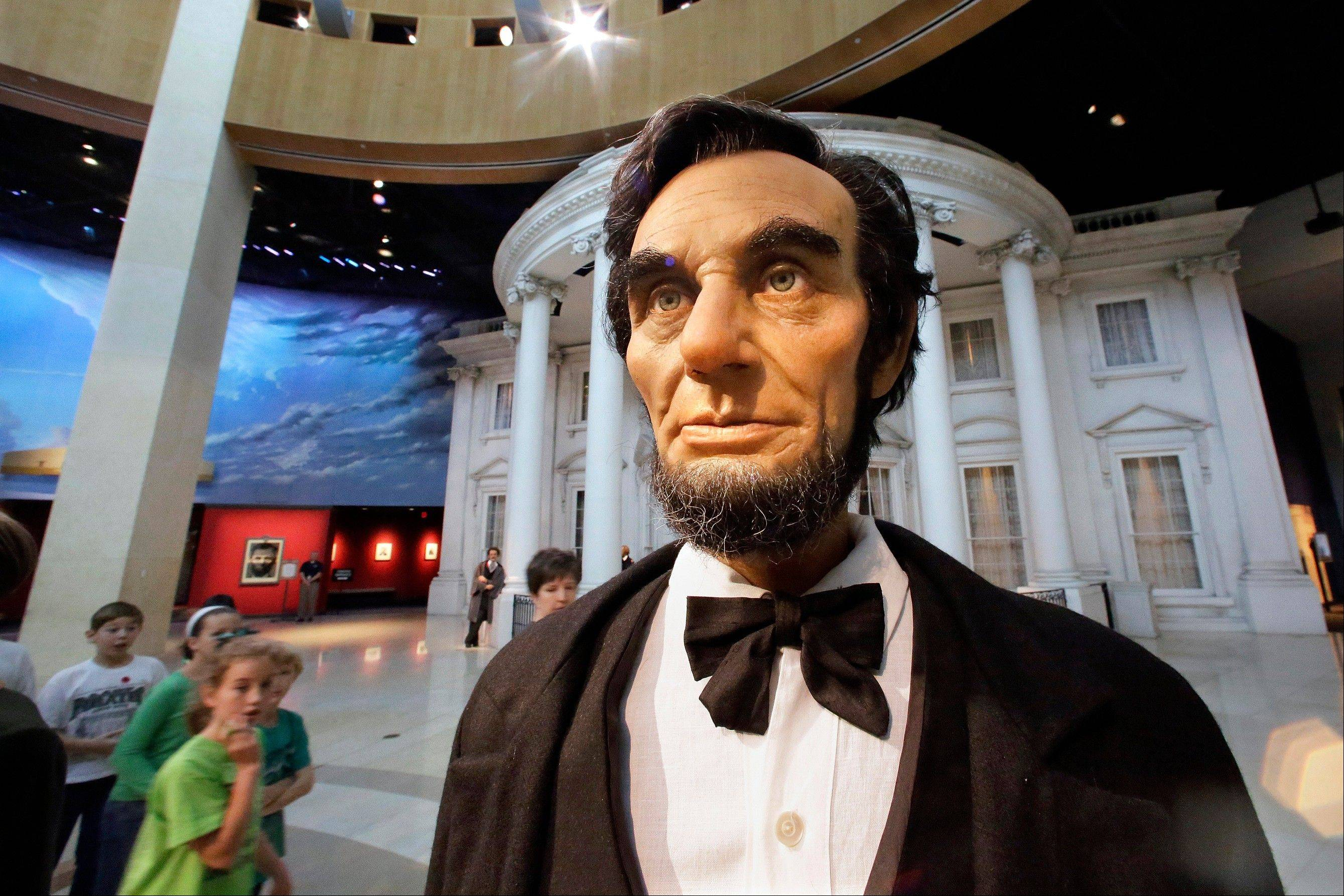 School groups and visitors tour the Abraham Lincoln Presidential Museum and Library Friday.