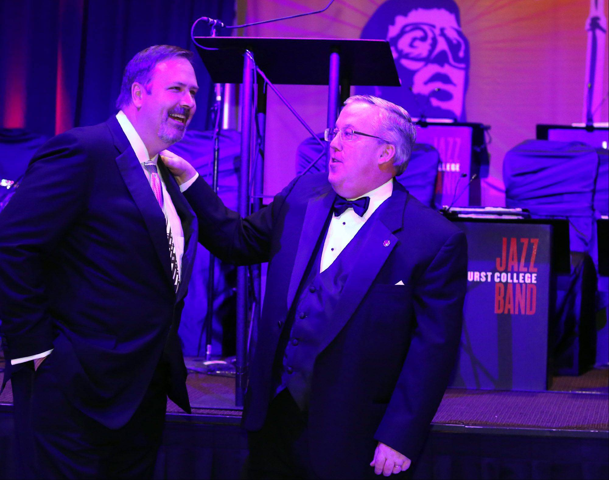 George LeClaire/gleclaire@dailyherald.comRobert O'Meara, president of Shelter, Inc. board of directors, of Barrington, right, speaks with Richard Sykes of Inverness before O'Meara presented Sykes with the Paul Buckholz award at the Shelter Ball at the Hyatt Recency on Friday in Schaumburg.