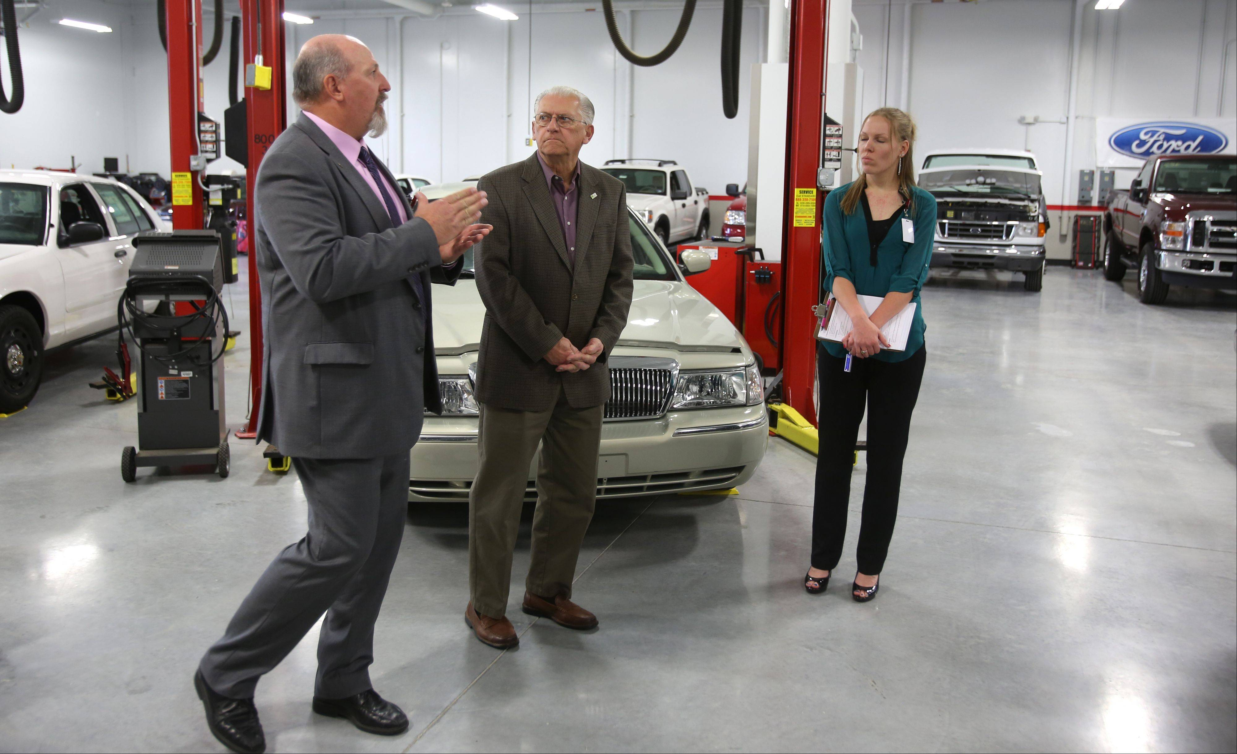Lisle Mayor Joe Broda, center, listens to local marketing manager Mike Vivona, left, discuss the new UTI campus in Lisle. At right is Kim Norman, tour coordinator.