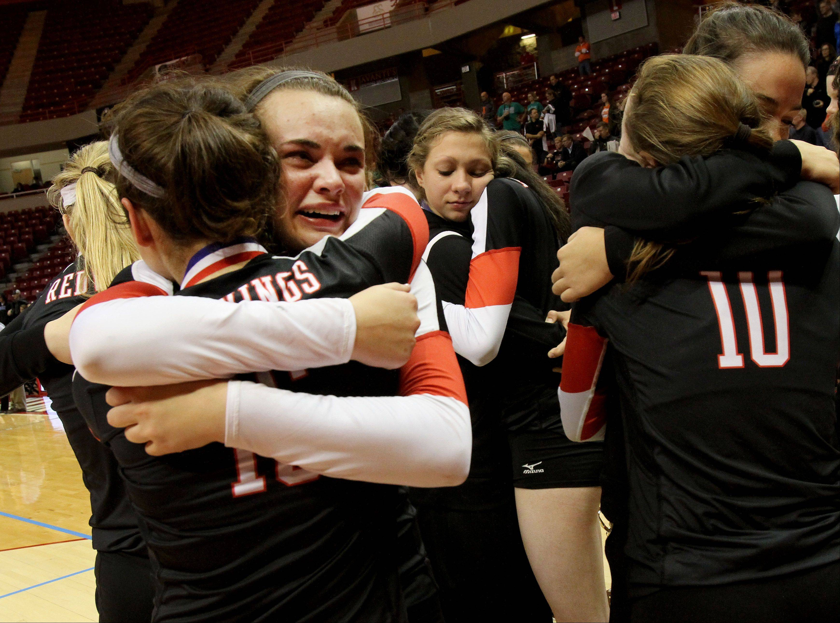 Benet players console each other after their loss to Mother McAuley in the Class 4A championship girls volleyball match on Saturday in Normal.