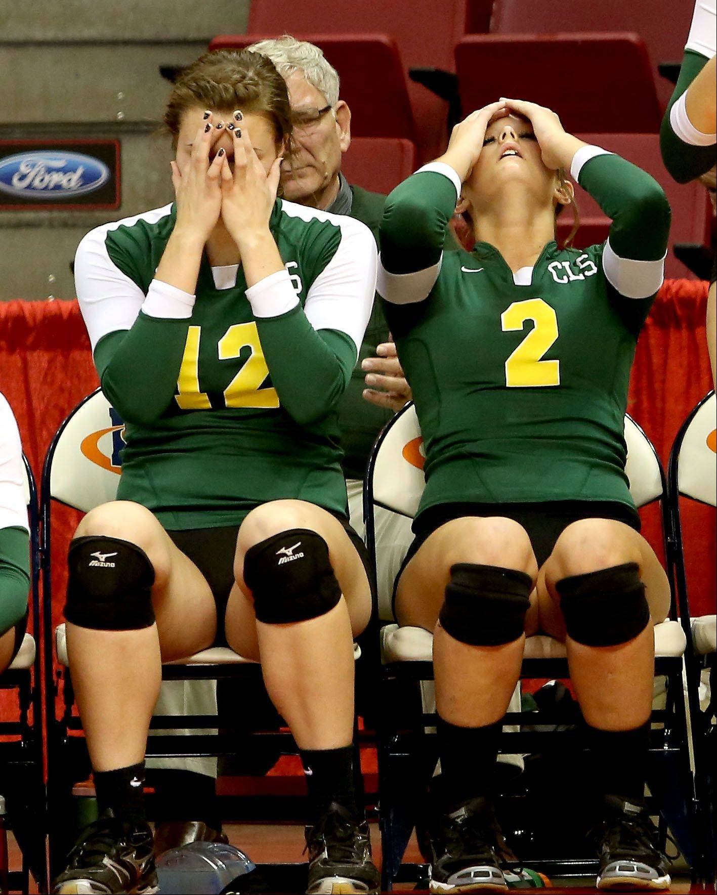 Nicole Slimko, left and Emma Burkle of Crystal Lake South react to their loss in three sets to New Trier in the Class 4A third place girls volleyball match on Saturday in Normal.