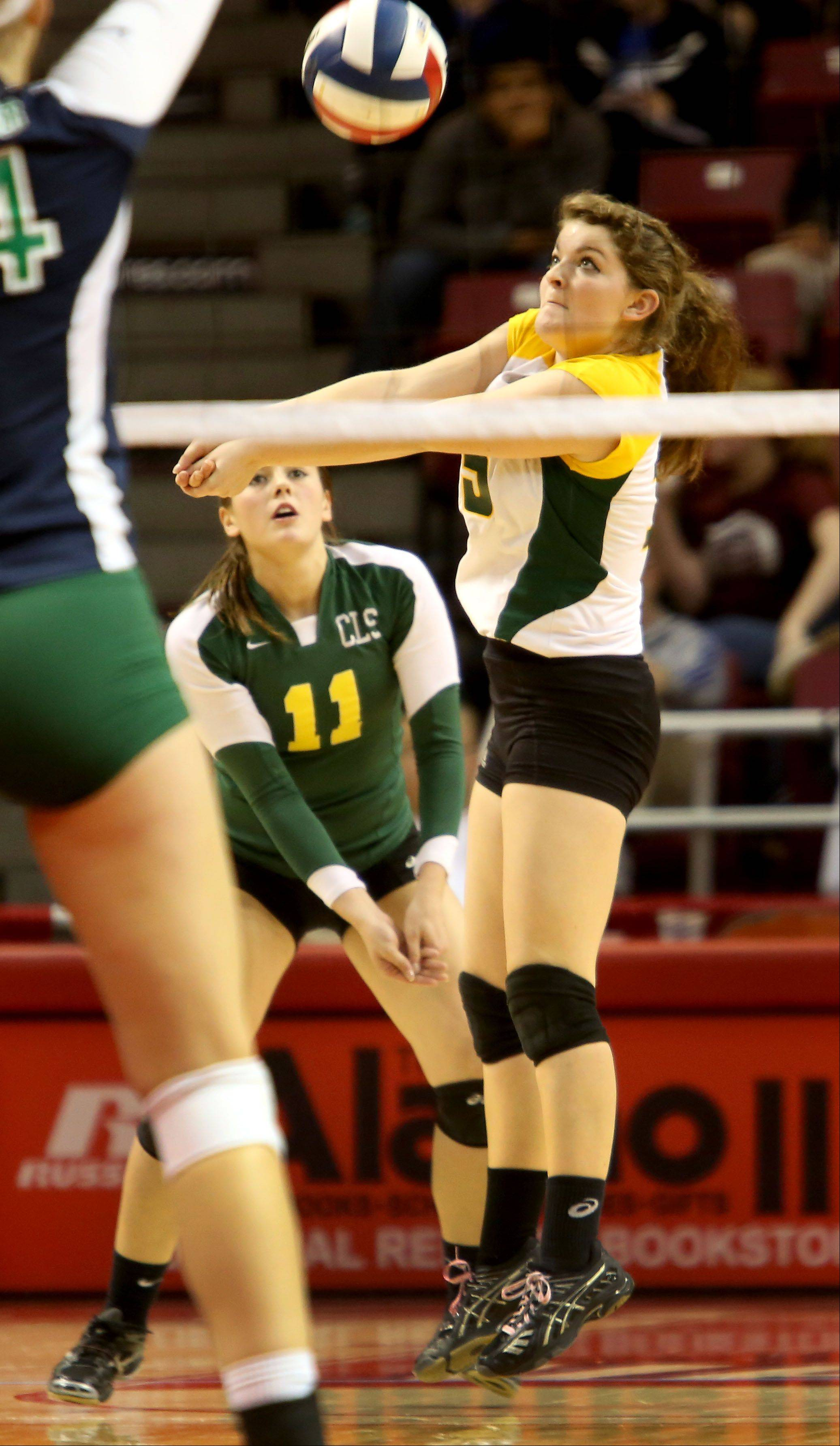 Hannah Wilson of Crystal Lake South returns a shot to New Trier in the Class 4A third place girls volleyball match on Saturday in Normal.