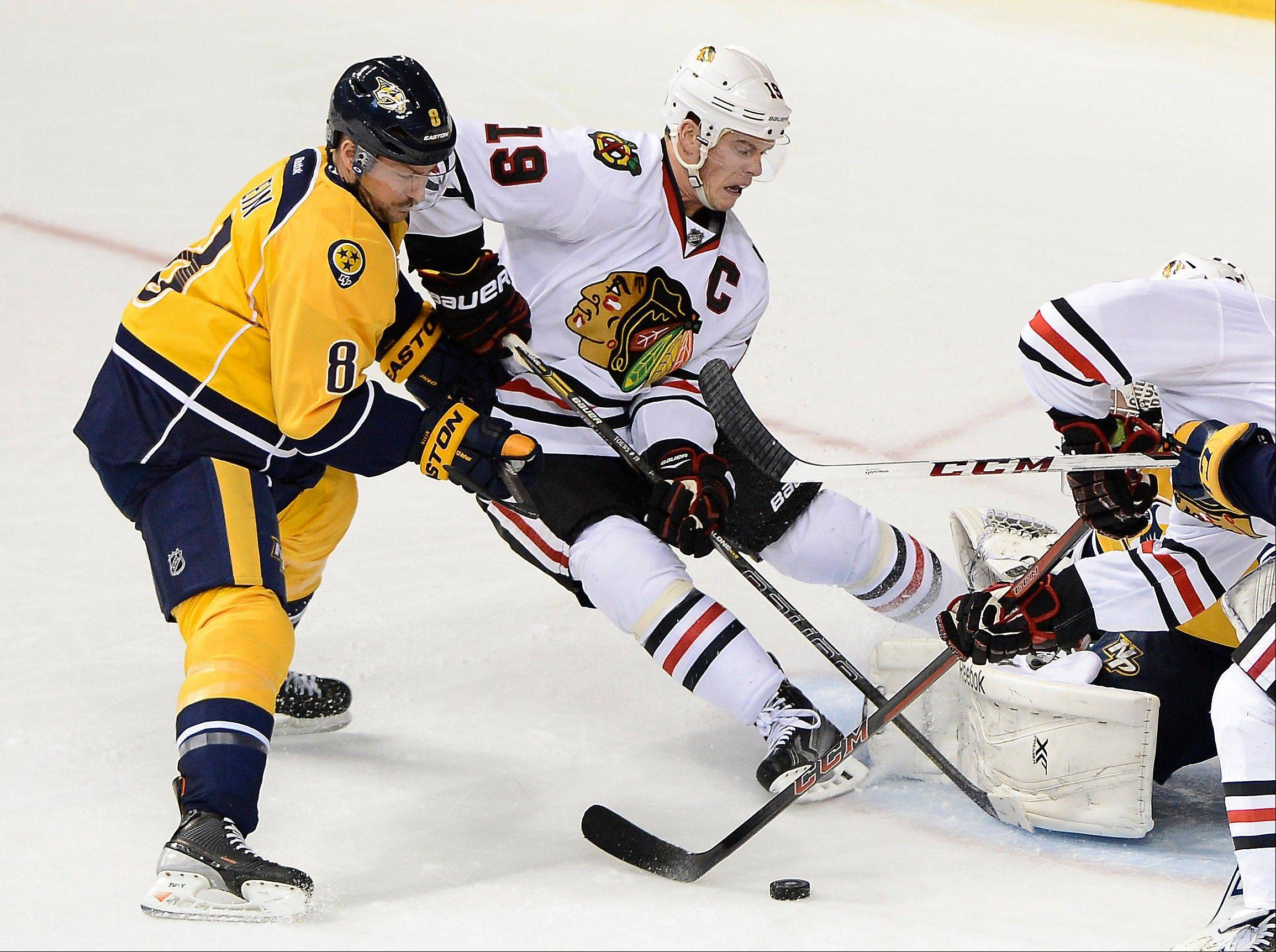 Predators defenseman Kevin Klein (8) stops Blackhawks center Jonathan Toews (19) from shooting the puck in front of the net during Saturday's game in Nashville.