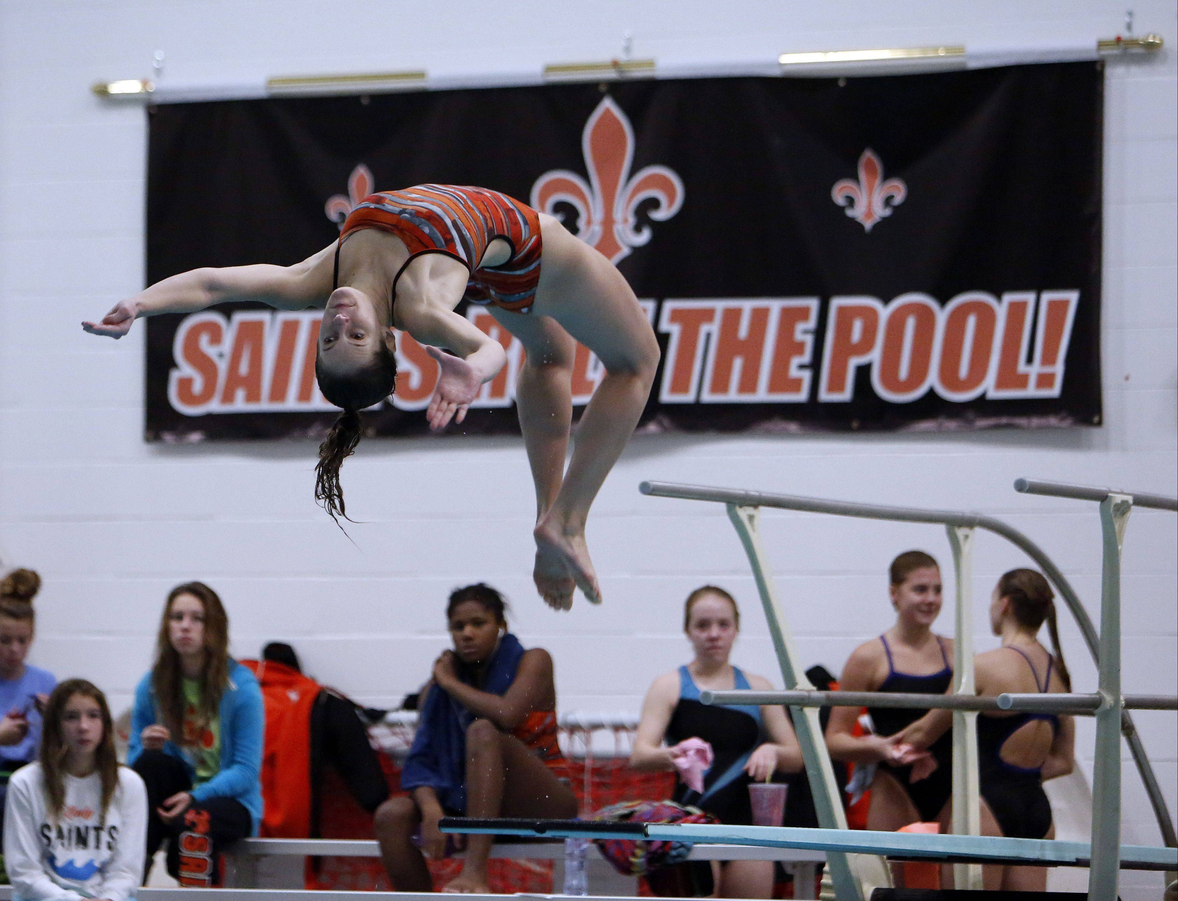 St. Charles East's Dana Ritter dives at the Saints' sectional Saturday.