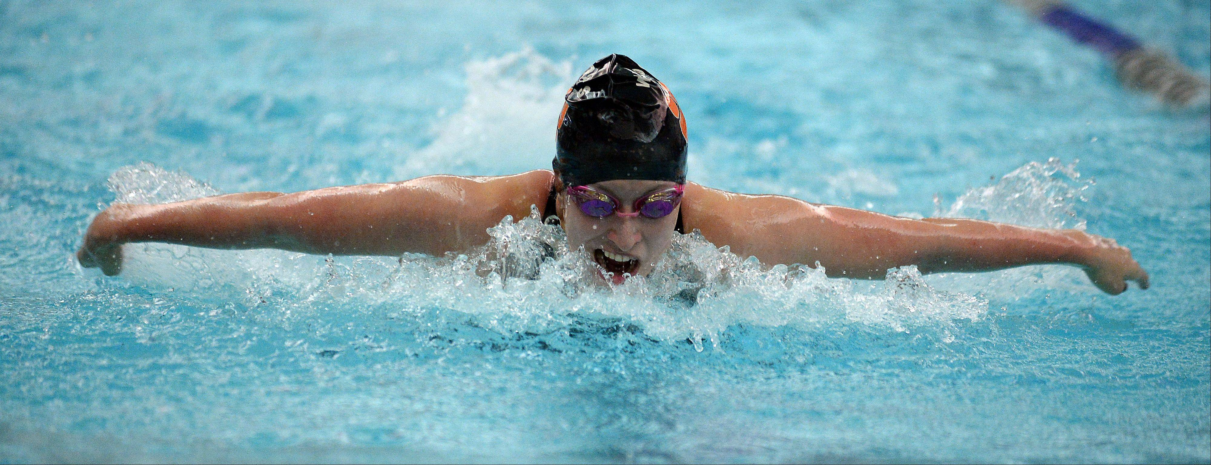 Libertyville's Staci Herchenbach powers ahead in the girls 100-yard butterfly in the girls swimming sectional at Vernon Hills High School on Saturday.