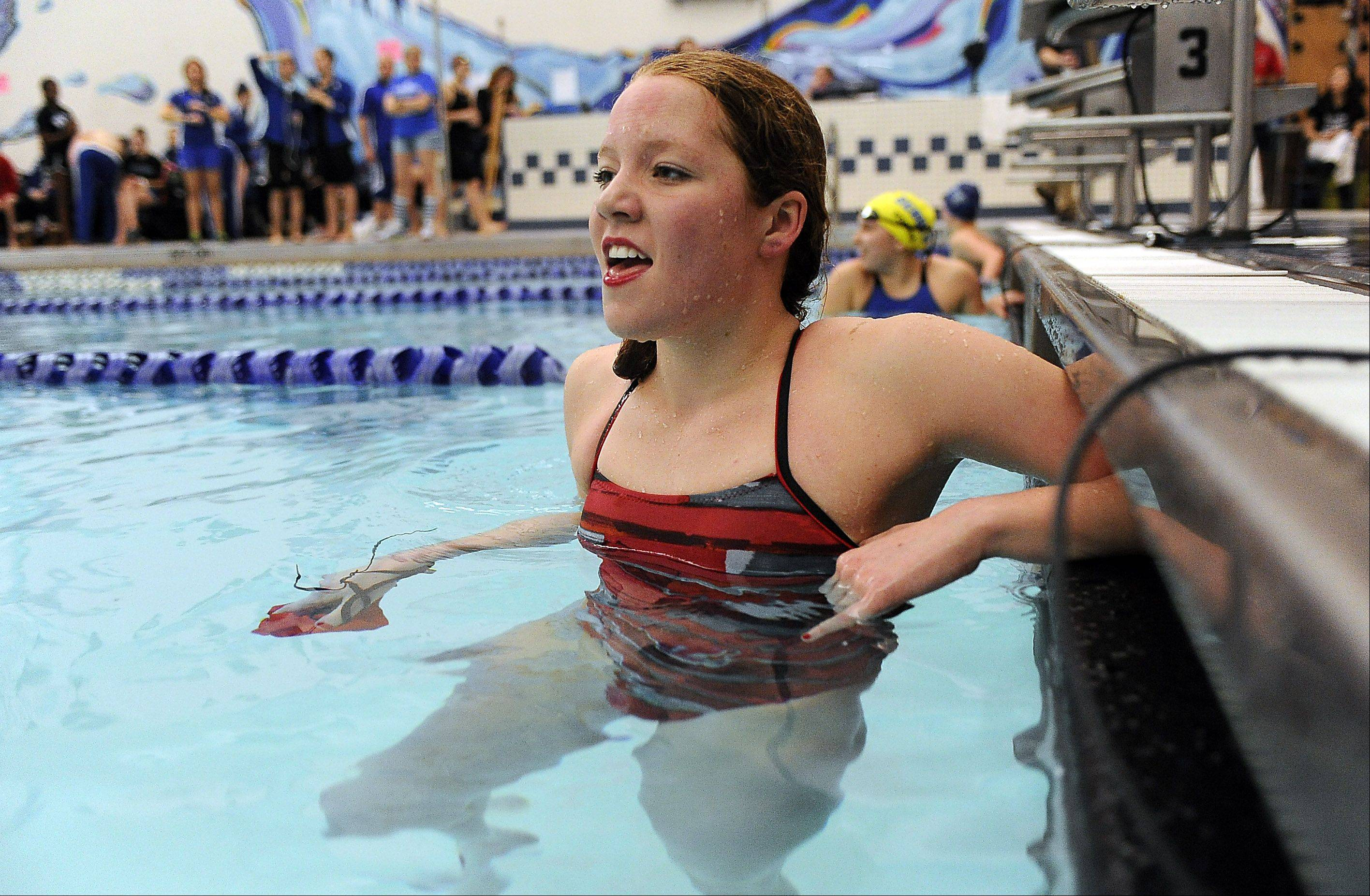 Mundelein's Erin Falconer is all smiles after winning the girls 200-yard freestyle in sectional swimming at Vernon Hills High School on Saturday.