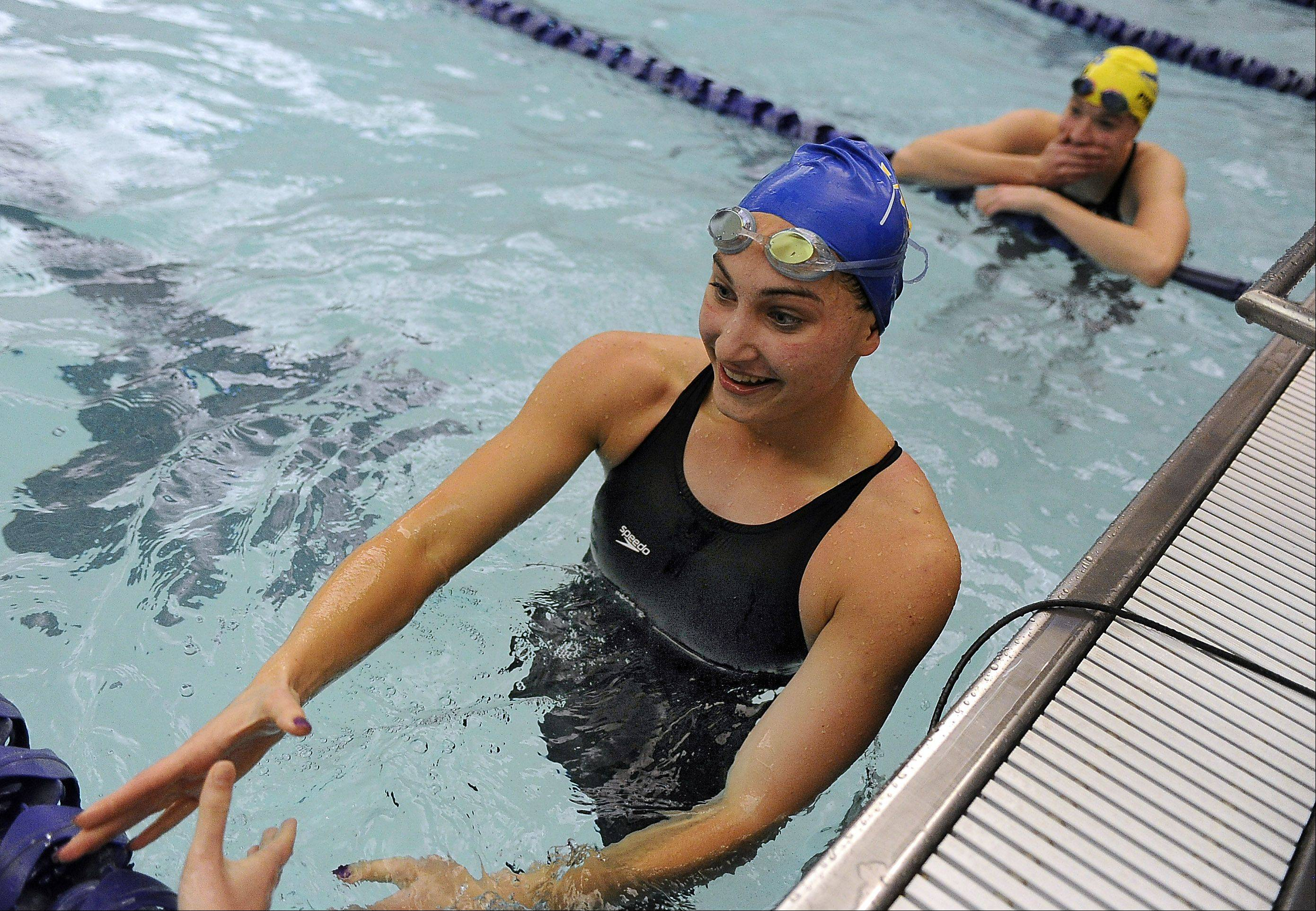 Mark Welsh/mwelsh@dailyherald.comWarren's Paige Wells likes her second-place finish in the 50-yard freestyle in sectional swimming at Vernon Hills High School on Saturday.