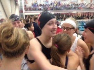 Palatine's Kristin Anderson is swarmed by well-wishers on Saturday at Barrington after qualifying for the state meet in the 50-yard freestyle.