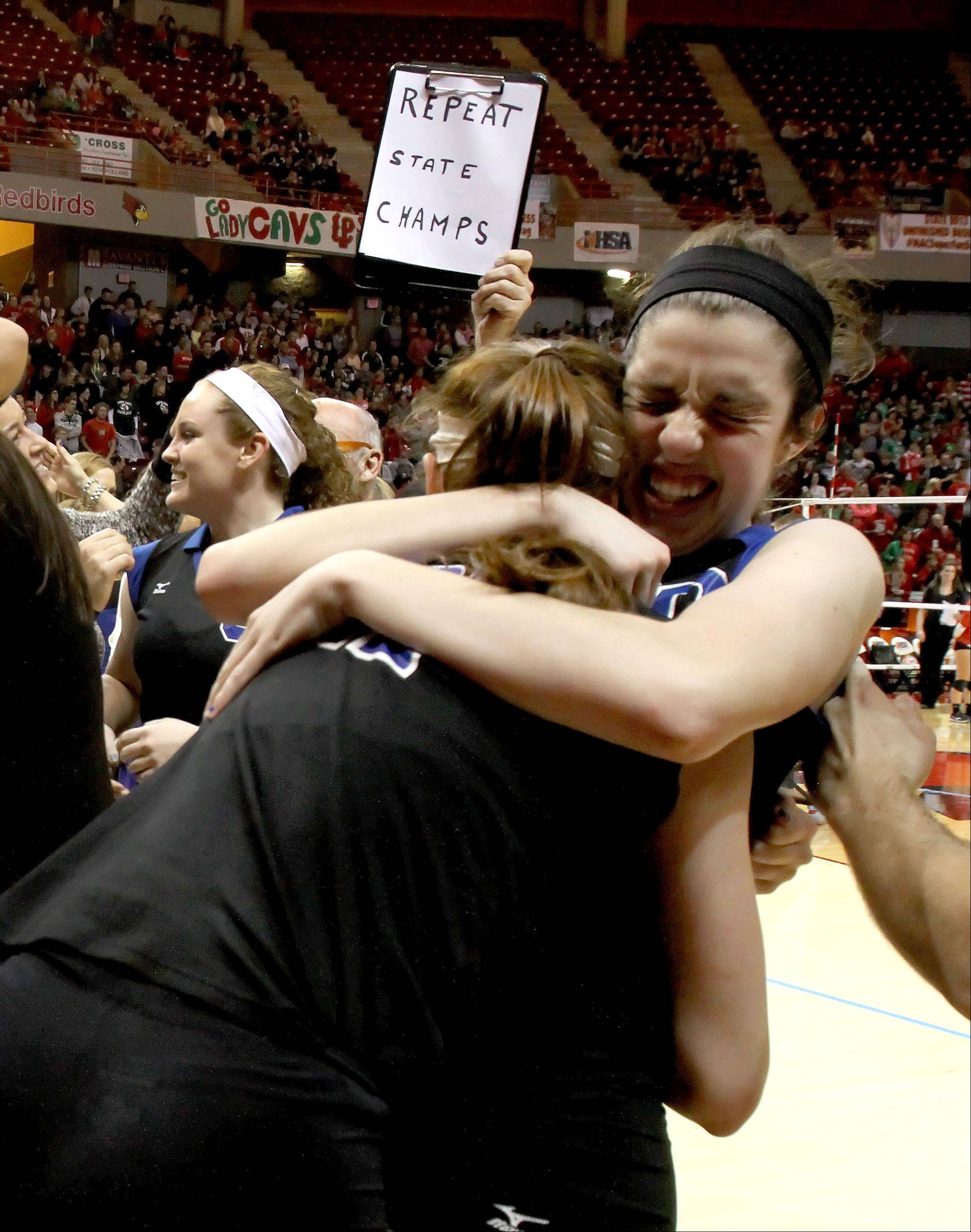 Kamryn Malloy of St. Francis gets a hug from teammates after they beat LaSalle-Peru in the Class 3A championship girls volleyball match on Saturday in Normal.