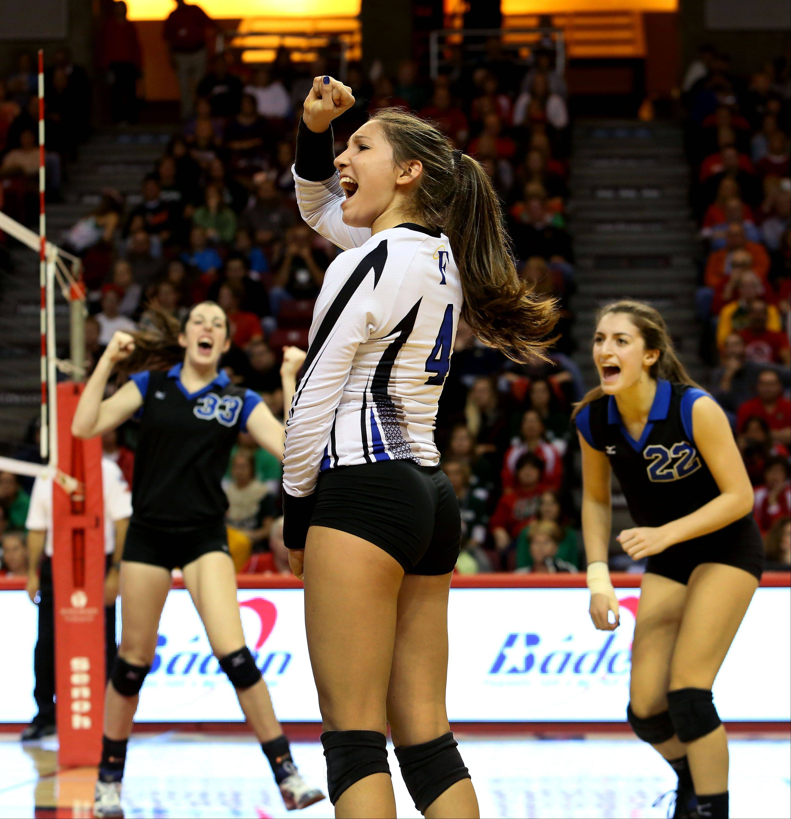 Sam Dubiel and her St. Francis teammates celebrate a point won over LaSalle-Peru in the Class 3A championship girls volleyball match on Saturday in Normal.