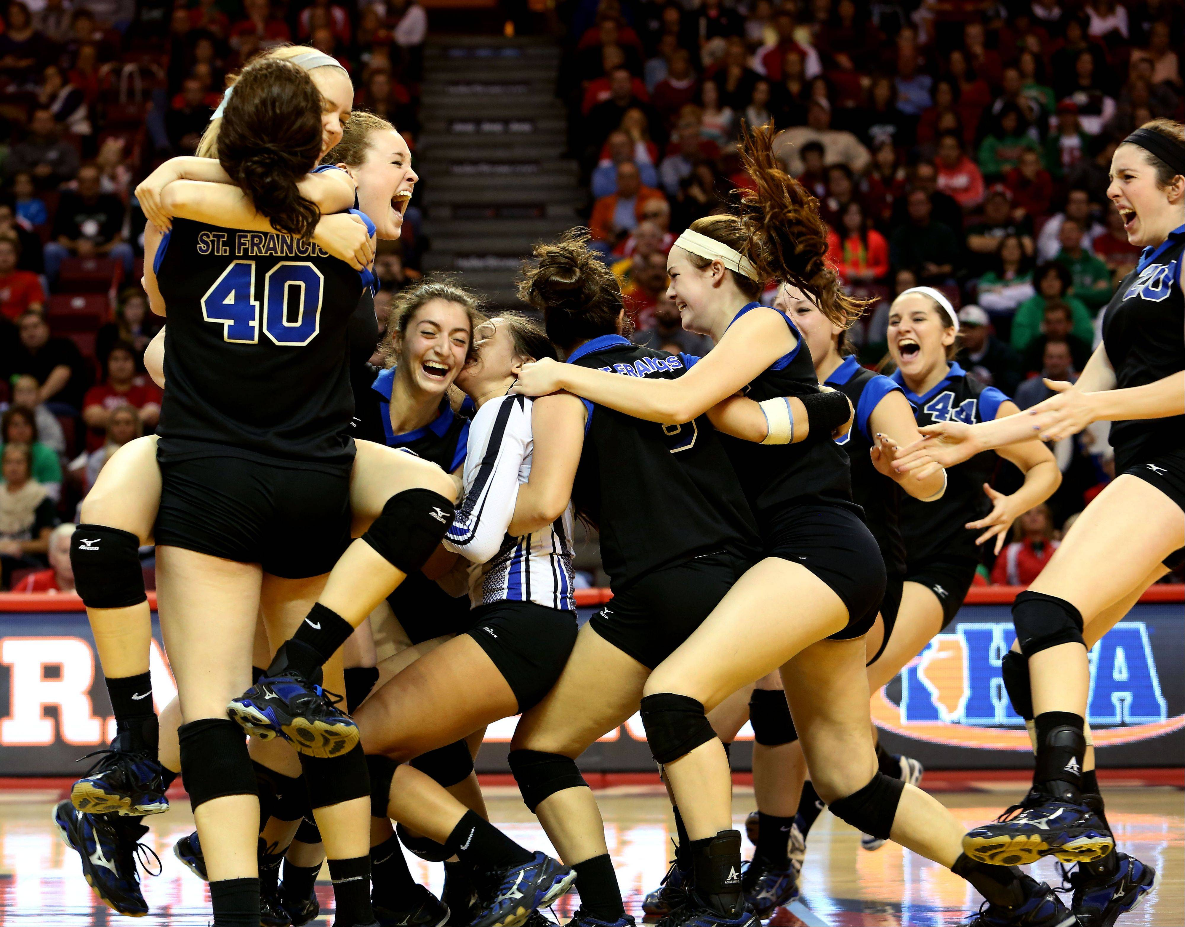 St. Francis celebrate after beating LaSalle-Peru in two games for the Class 3A championship in girls volleyball on Saturday in Normal.