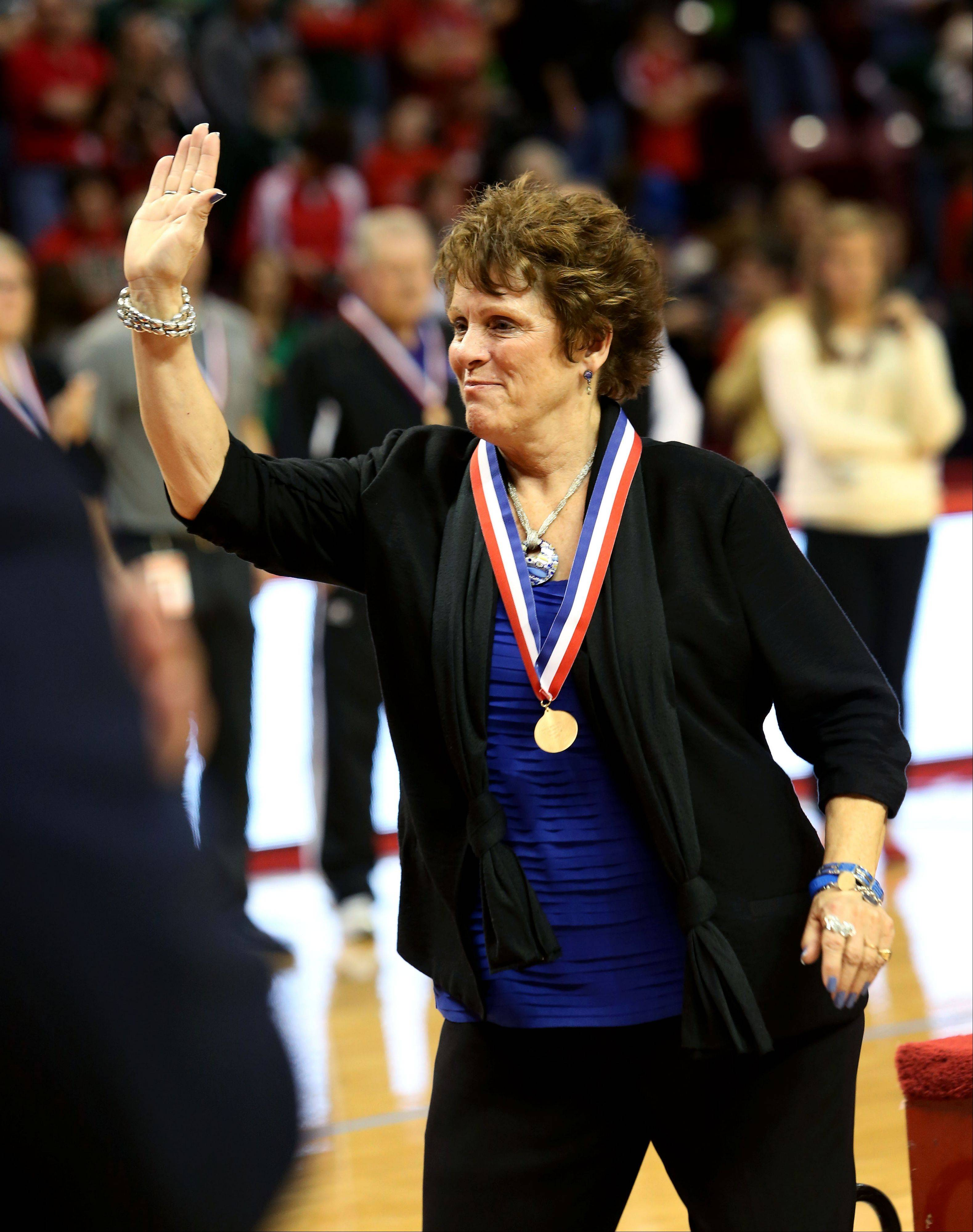 St. Francis coach Peg Kopec takes home another win in the Class 3A championship girls volleyball on Saturday in Normal.