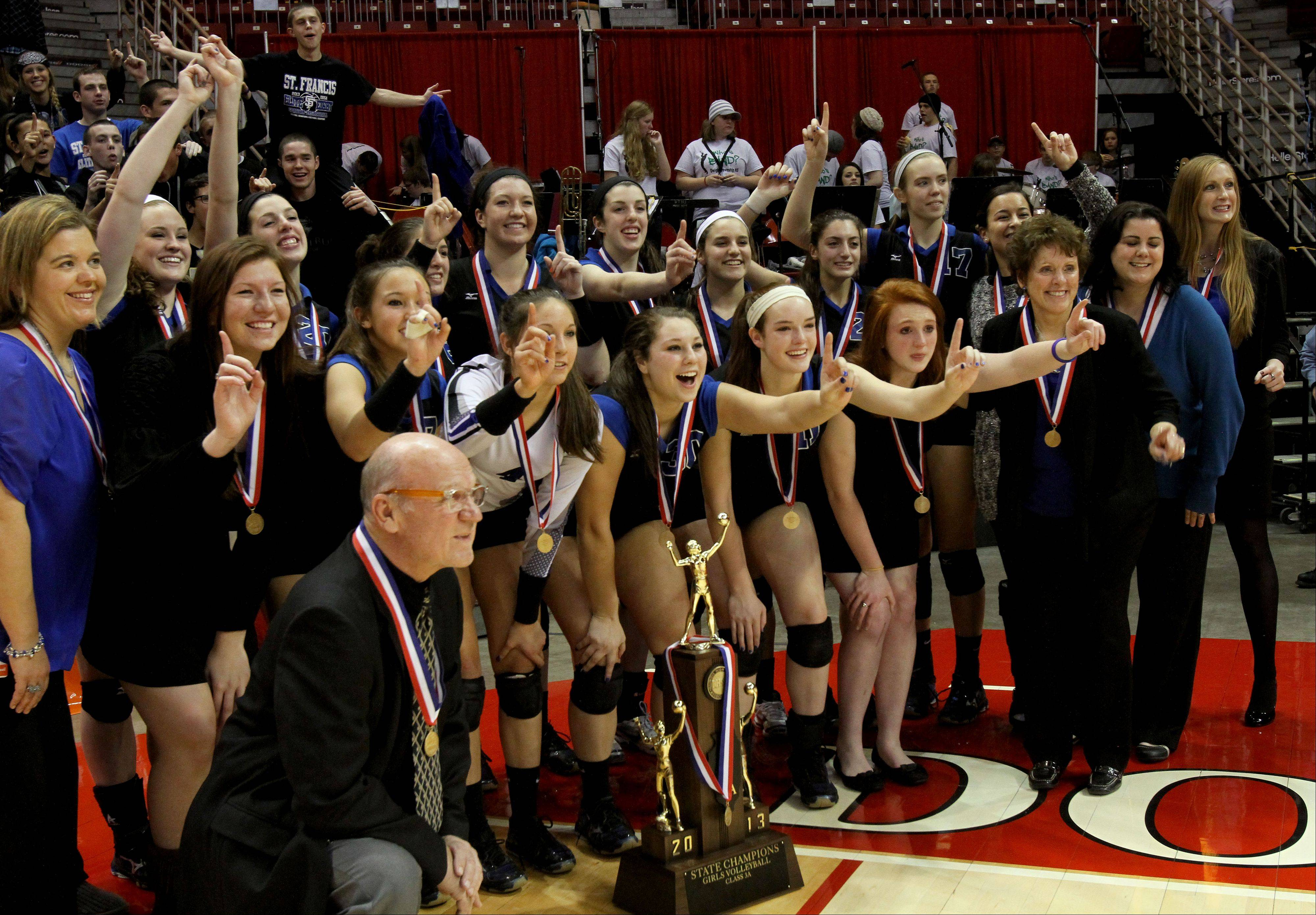 St. Francis poses with their trophy after beating LaSalle-Peru in the Class 3A championship girls volleyball match on Saturday in Normal.
