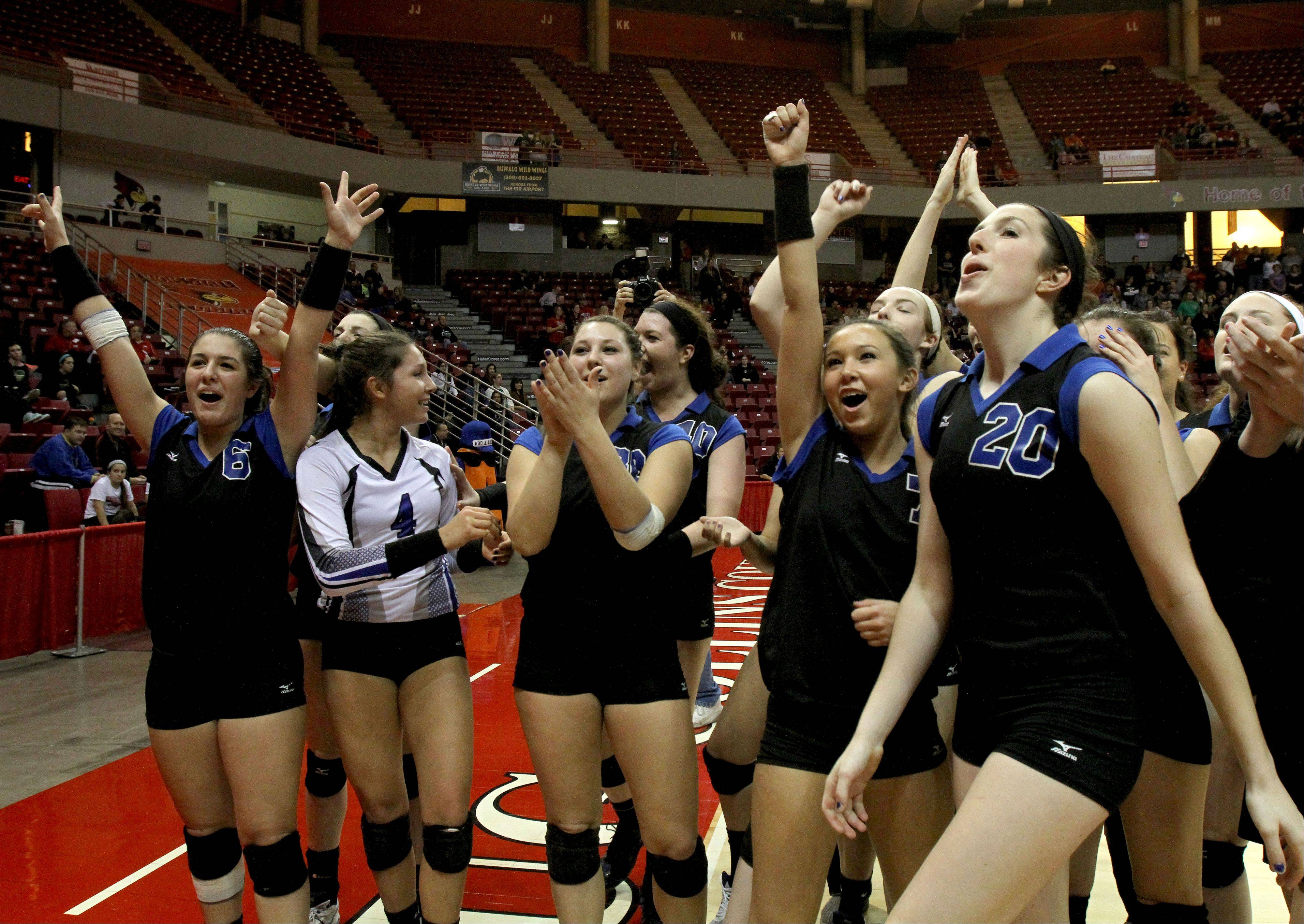 St. Francis greet their fans after winning the Class 3A championship in girls volleyball on Saturday in Normal.