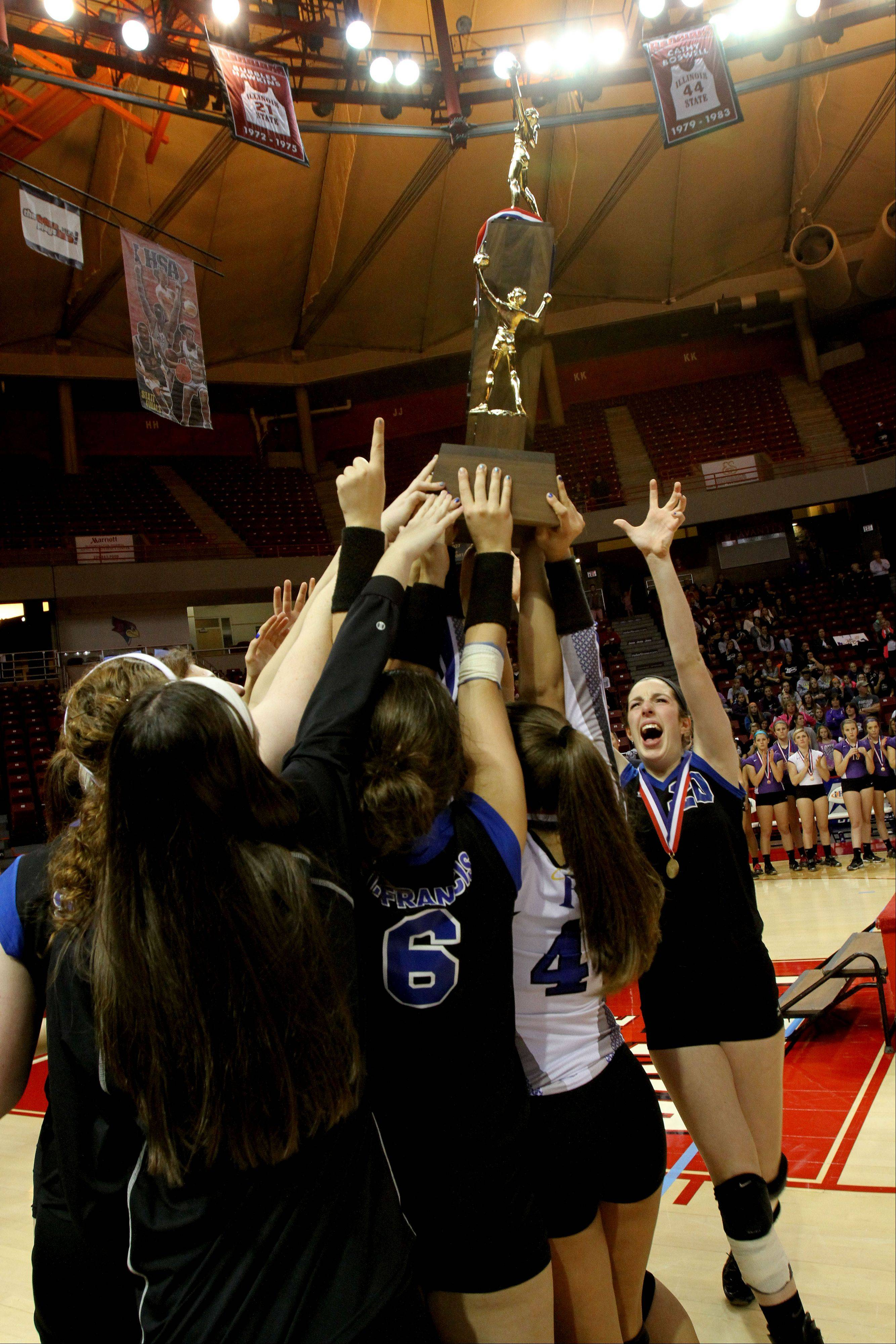 St. Francis holds up its trophy after beating LaSalle-Peru in the Class 3A championship girls volleyball match on Saturday in Normal.