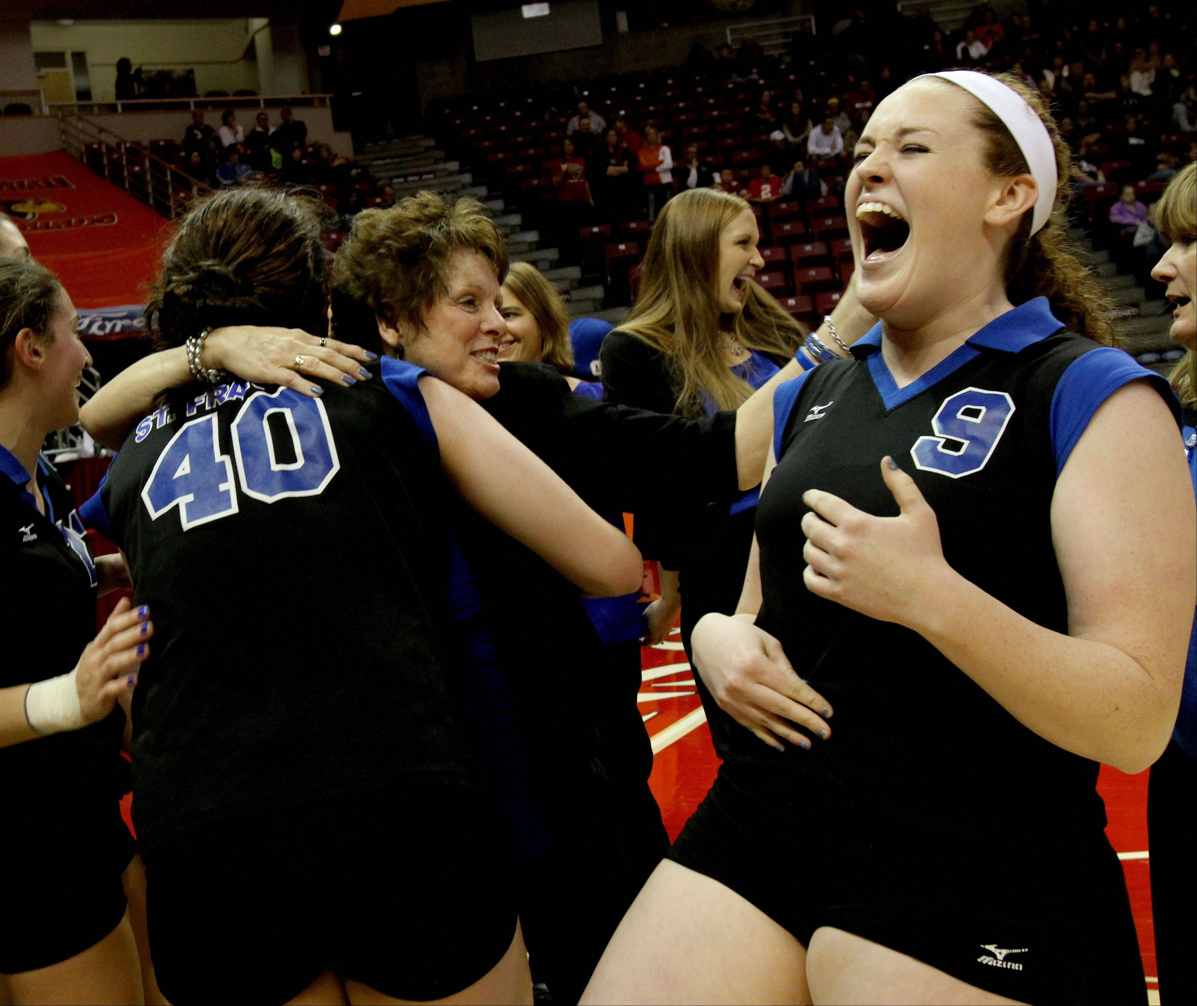 St. Francis coach Peg Kopec, center, hugs her players as Sarah Muisenga, right, celebrates after the Spartans beat LaSalle-Peru in two games for the Class 3A championship in girls volleyball on Saturday in Normal.