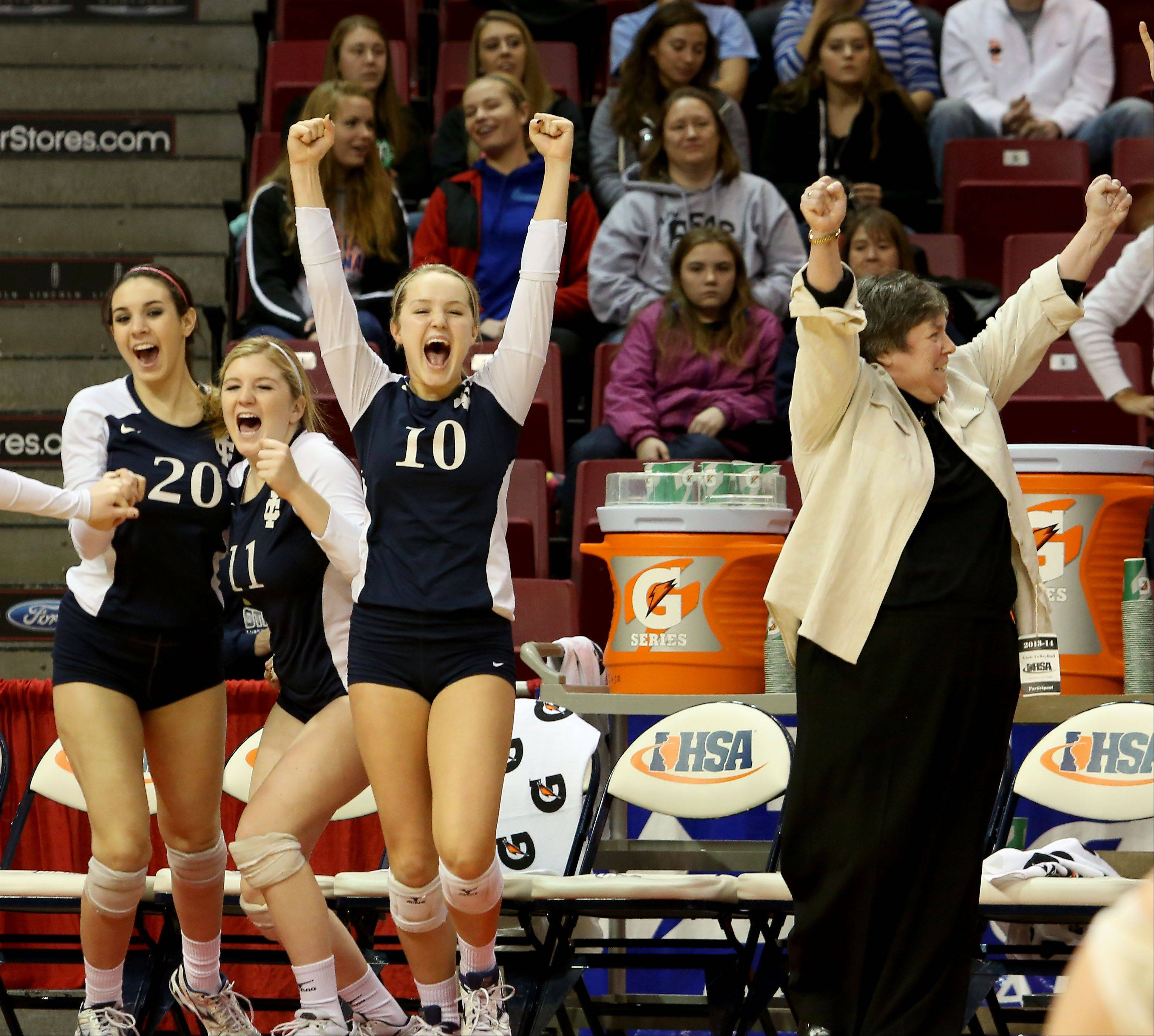 IC Catholic coach Jean Field and team react as they beat Edwards County to win the Class 2A championship girls volleyball match on Saturday in Normal.