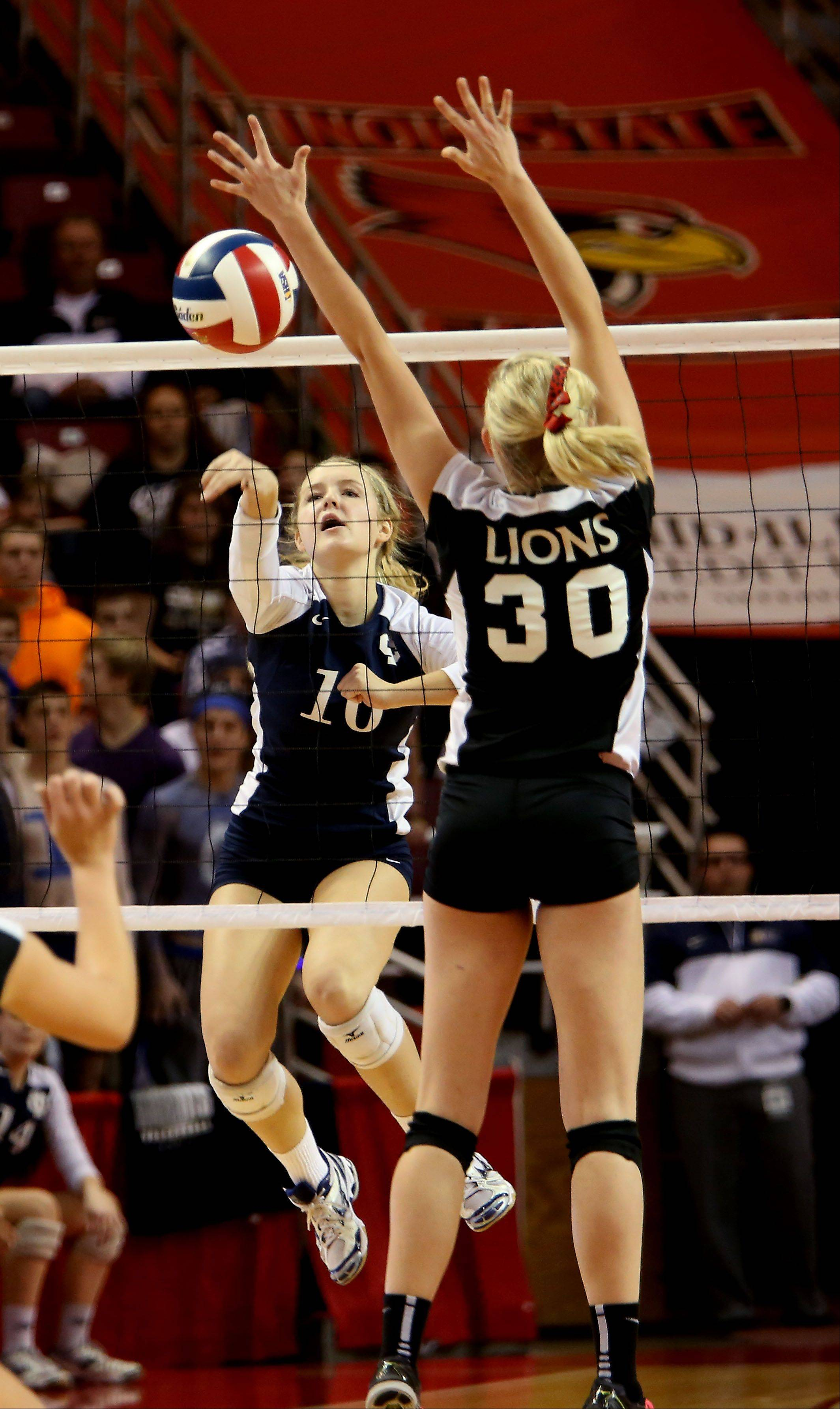 Hannah Hartnett of IC Catholic spikes the ball past kaeli James of Edwards County in the Class 2A championship girls volleyball match on Saturday in Normal.