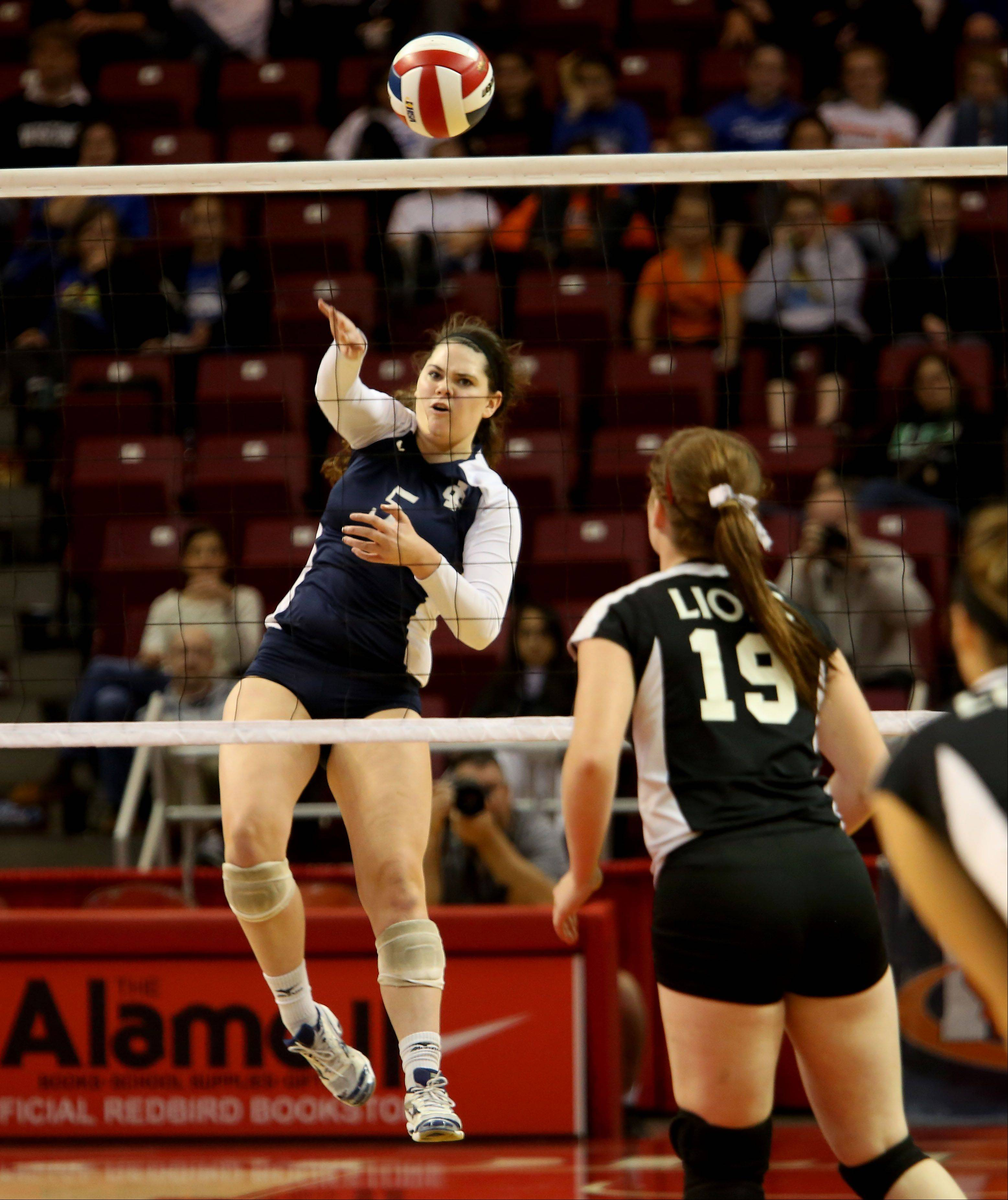 Rory Manion of IC Catholic gets the ball over to Edwards County in the Class 2A championship girls volleyball match on Saturday in Normal.