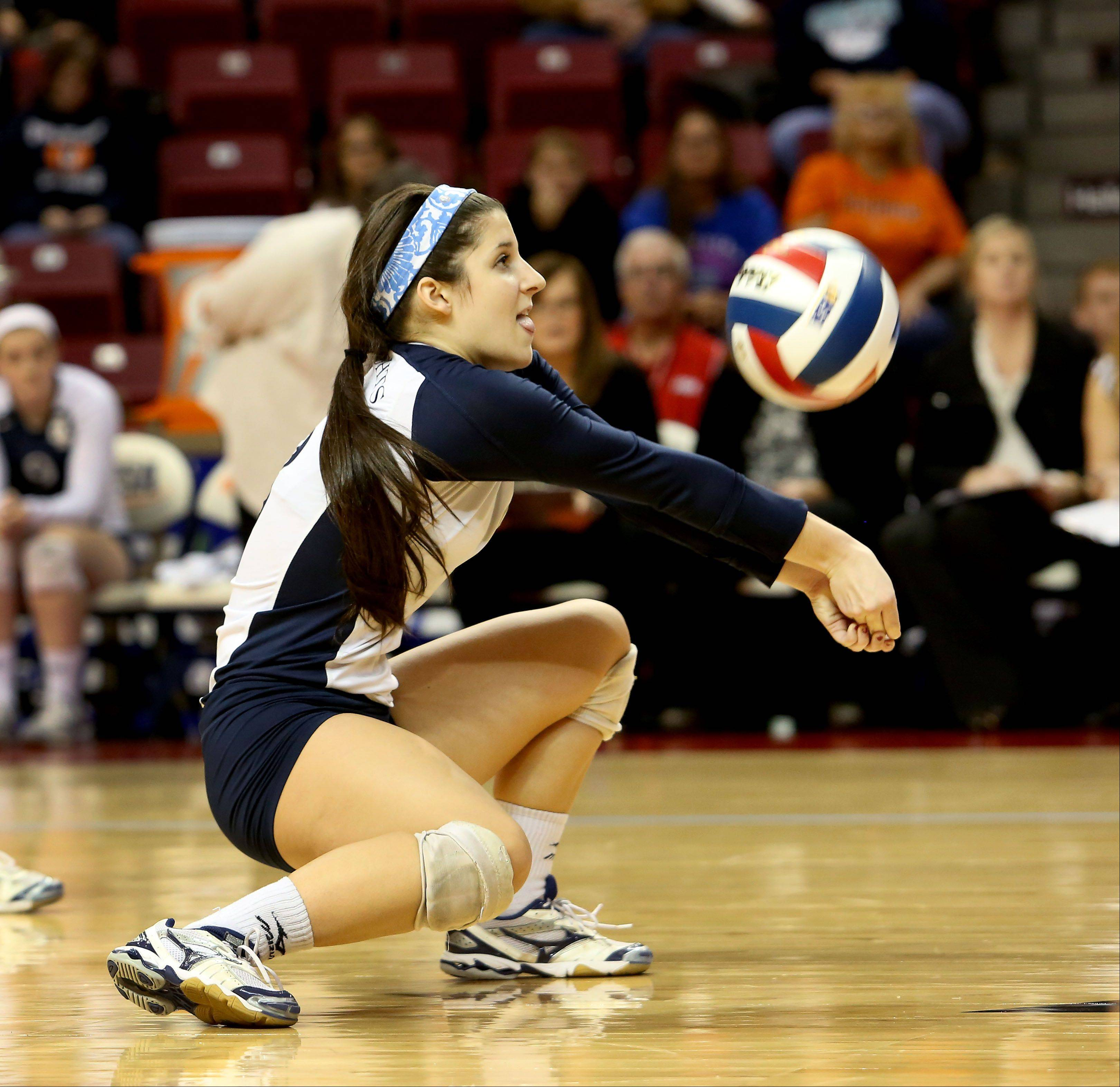 Kerry Mulligan of IC Catholic digs deep for a ball against Edwards County in the Class 2A championship girls volleyball match on Saturday in Normal.