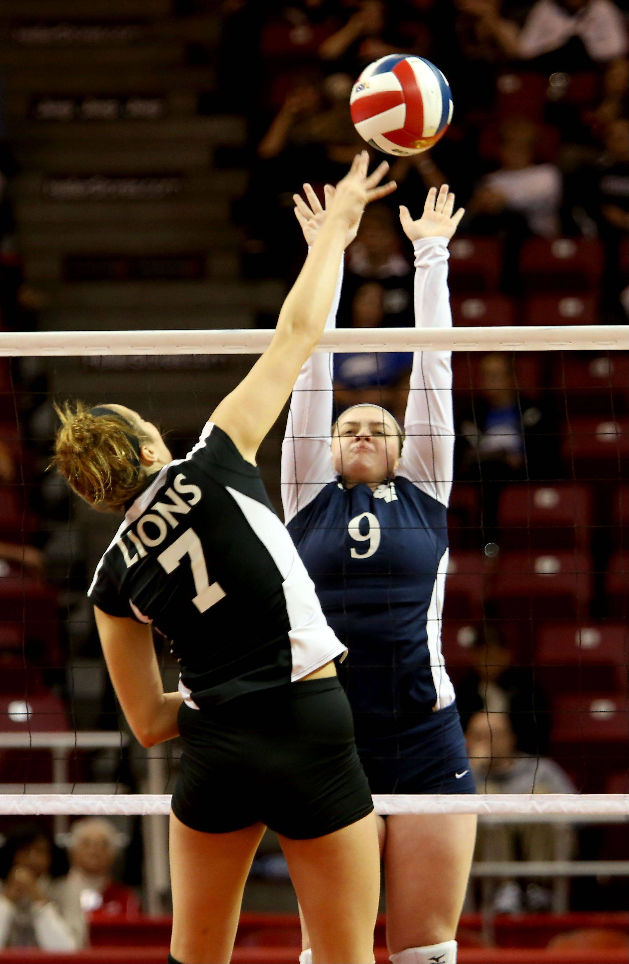 Frannie Cervone of IC Catholic goes up to block a shot by Riley Messman of Edwards County in the Class 2A championship girls volleyball match on Saturday in Normal.
