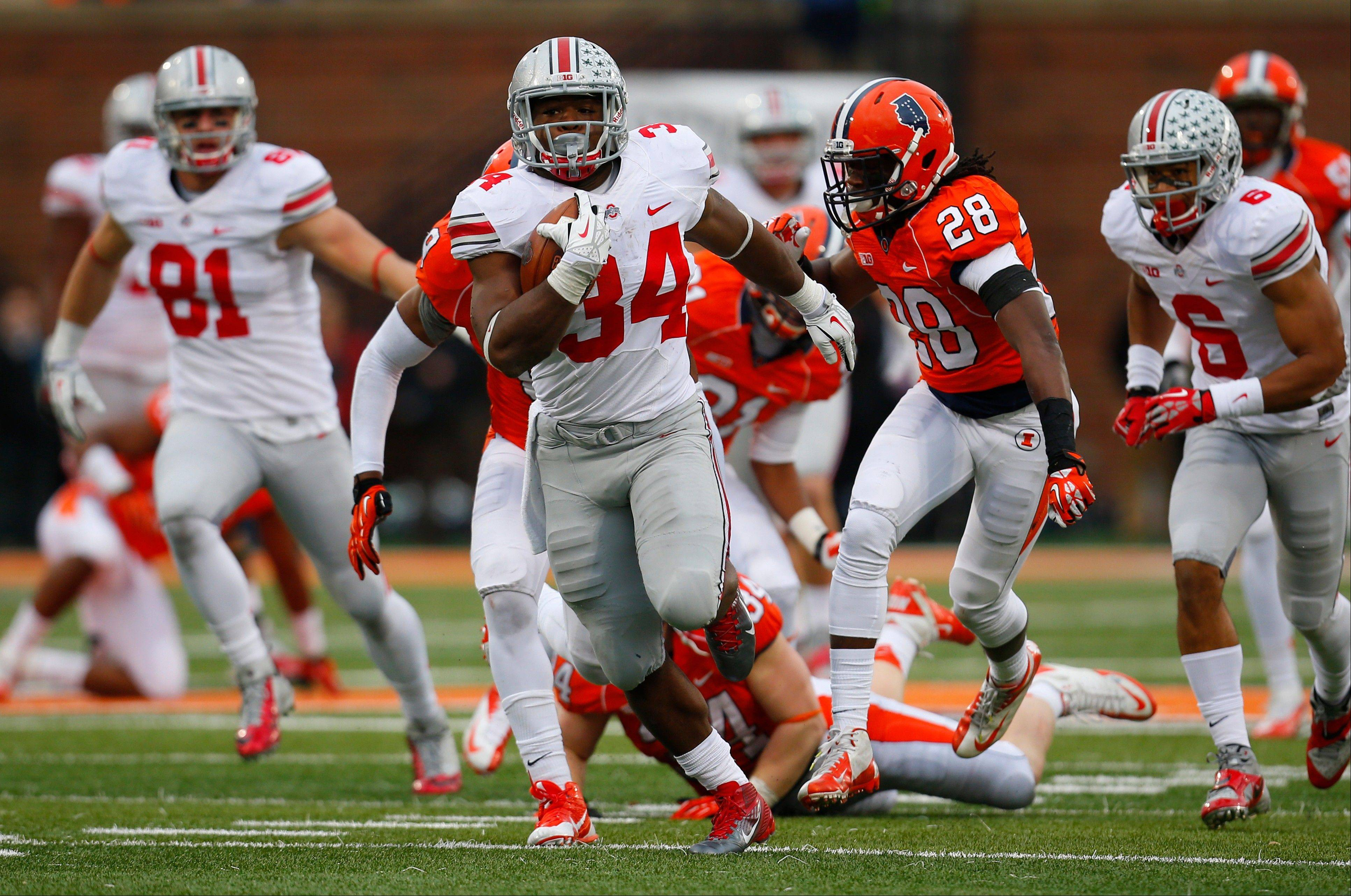 Ohio State running back Carlos Hyde (34) runs for a 51-yard touchdown during the second half of an NCAA college football game against Illinois on Saturday, Nov. 16, 2013, in Champaign, Ill. Ohio State won the game 60-35.