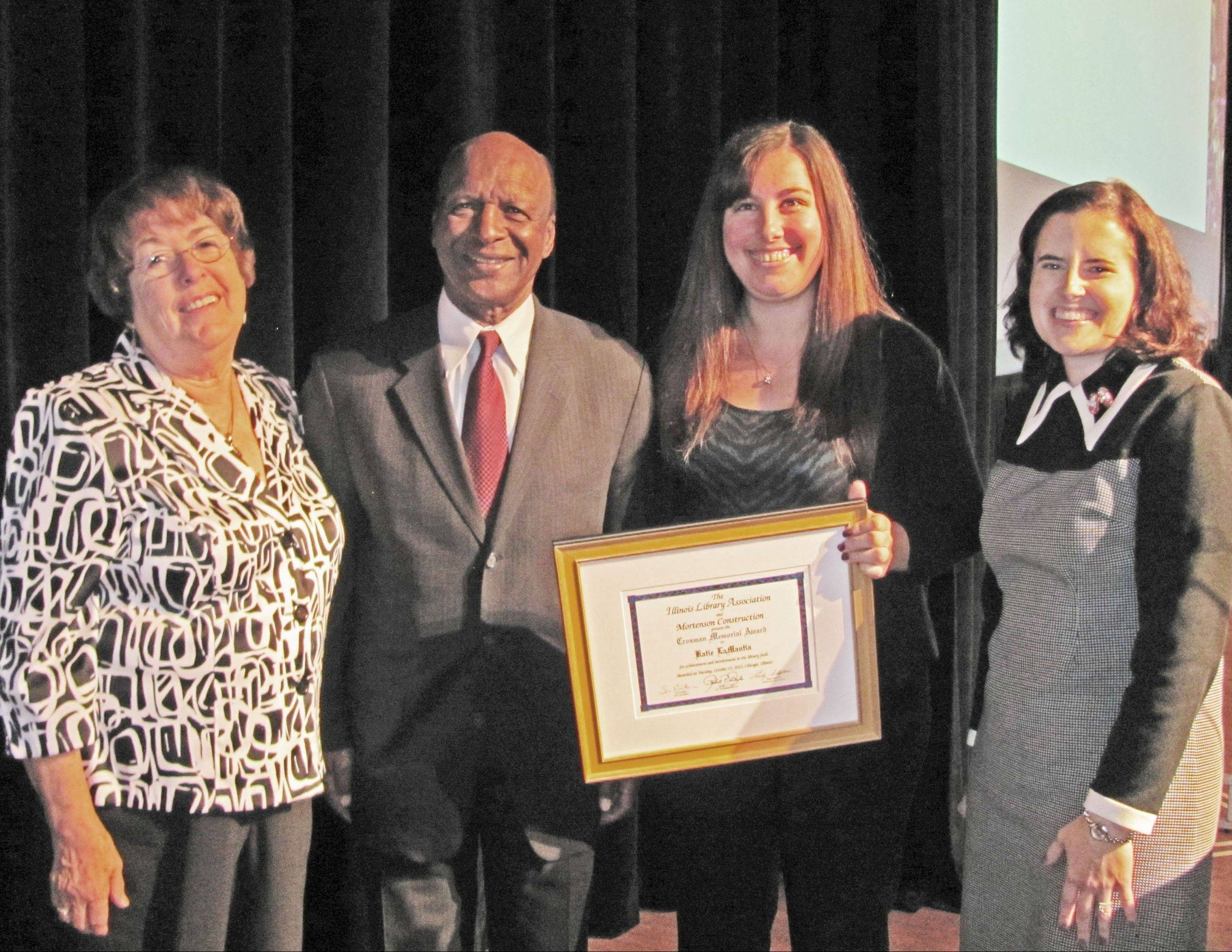 Pictured at the Illinois Library Association Awards presentation at Chicago's Navy Pier on Oct. 15, from left, are: Schaumburg Township District Library Literacy coordinator Pat Barch, Illinois Secretary of State Jesse White and Young Adult librarians Katie LaMantia and Amy Alessio.