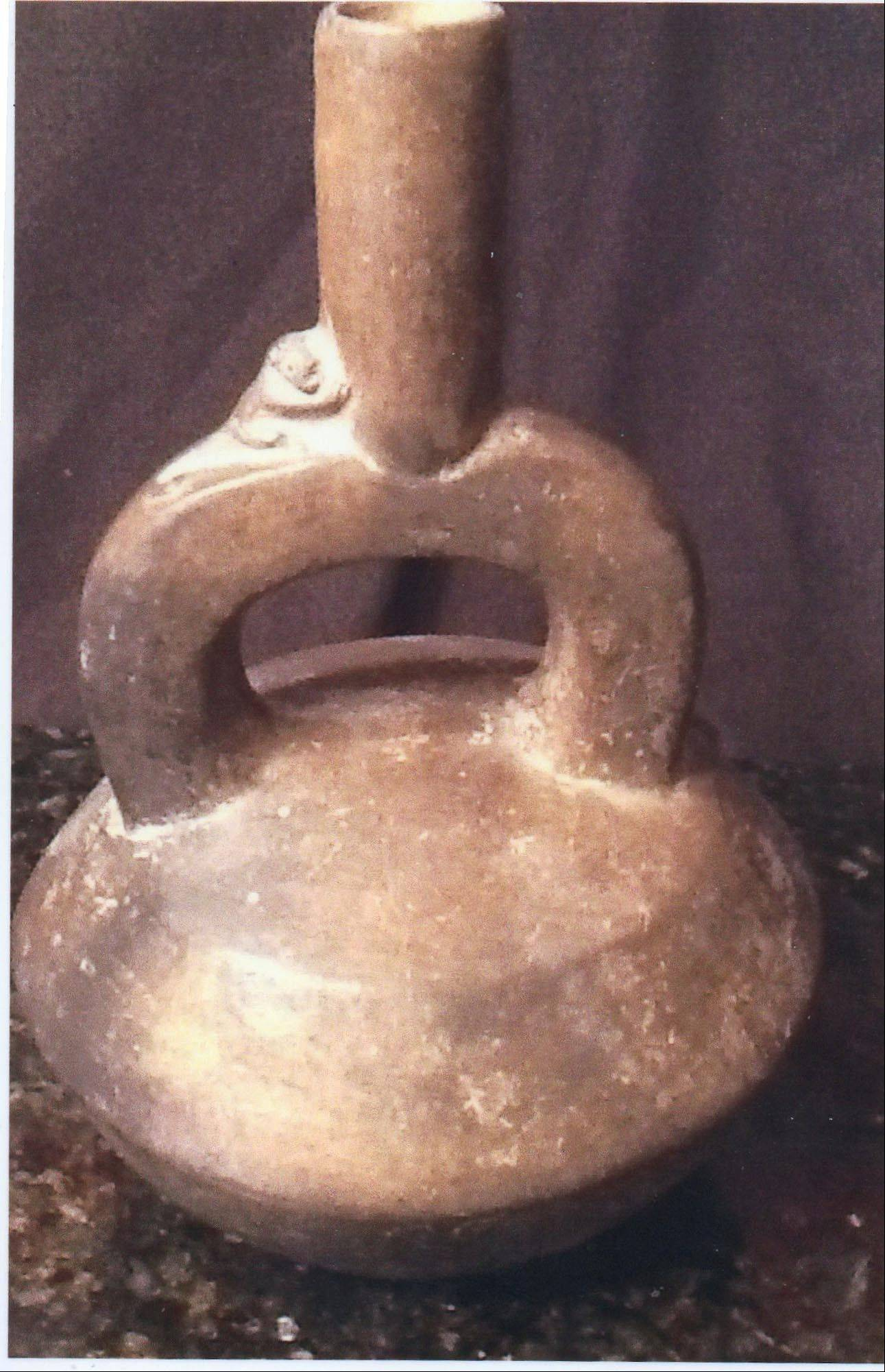 This stirrup vessel is a form popular with pre-Columbian people mainly located in Peru � but is it old?
