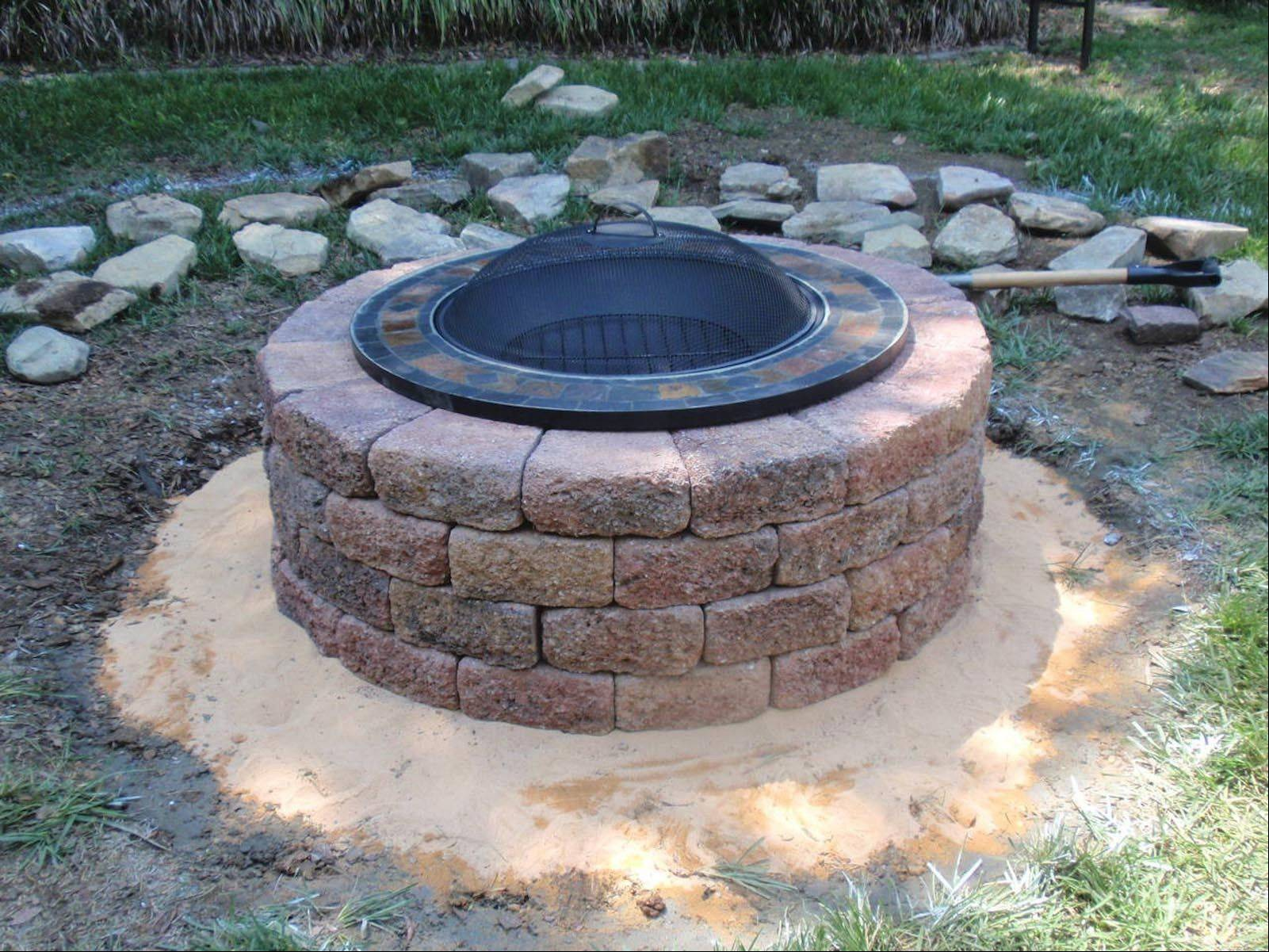 This simple fire pit was made from tumbled concrete pavers with diagonal edges that may be used as is, or add a metal insert as shown here.