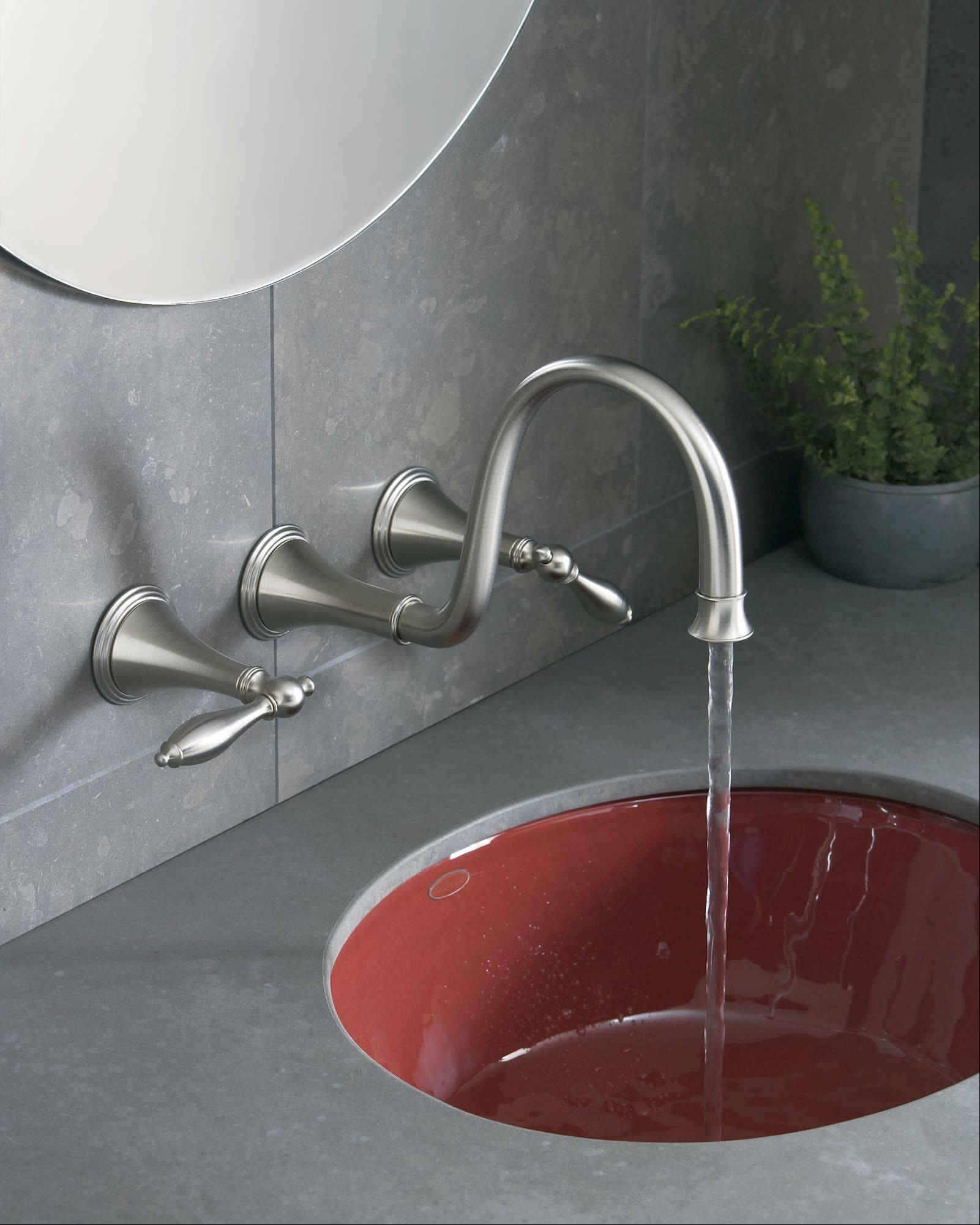 Wall-mounted bathroom faucets provide a very trendy look and can make it easier to clean the sink or counter, since the entire faucet is raised off the deck.