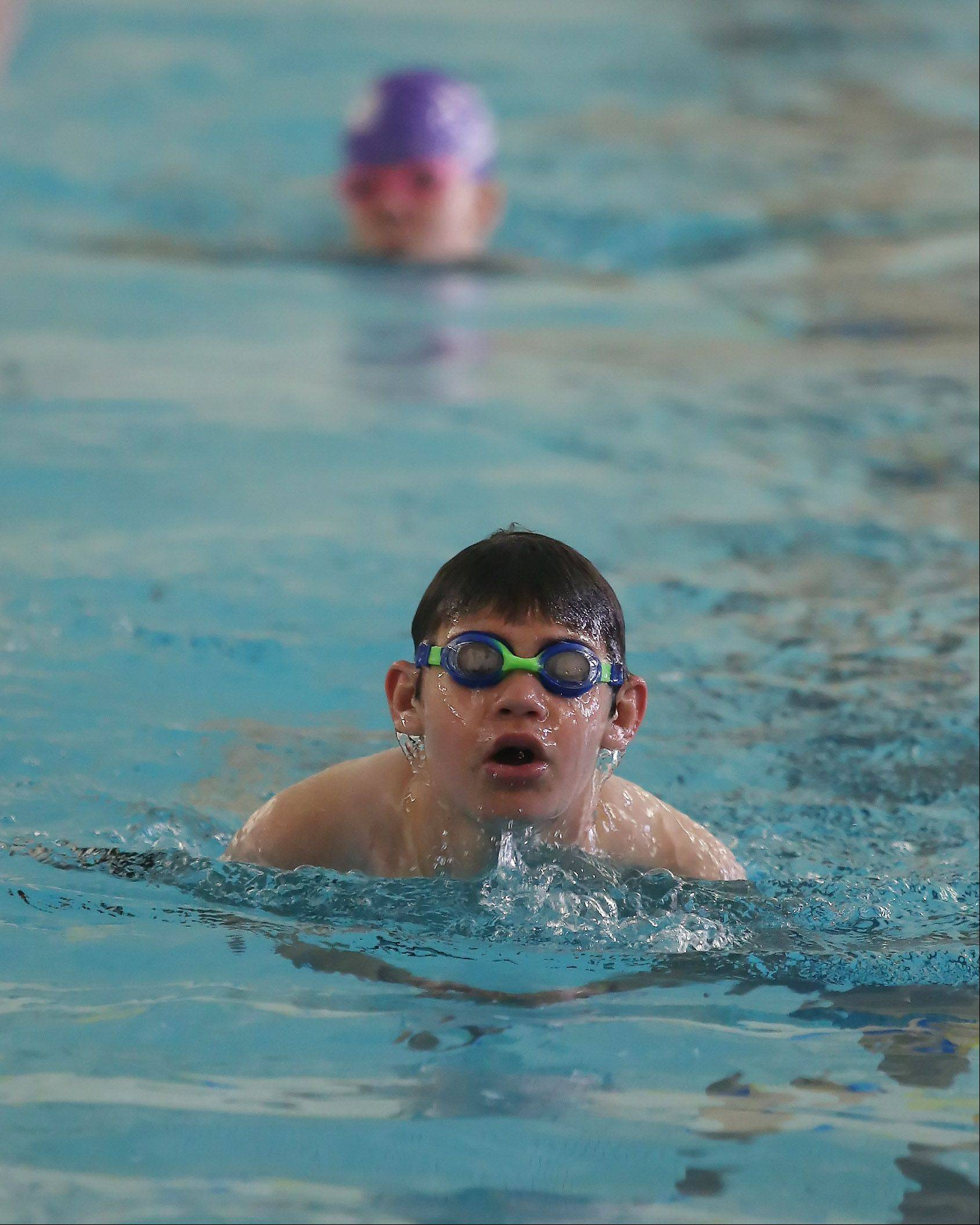 Ethan Burkhart of Libertyville swims the breast stroke Sunday during the Gateway to Gold talent identification event Sunday at Lake Forest High School. The event was hosted by the Great Lakes Adaptive Sports Association to recognize individuals who could represent the country at the Paralympic Games.