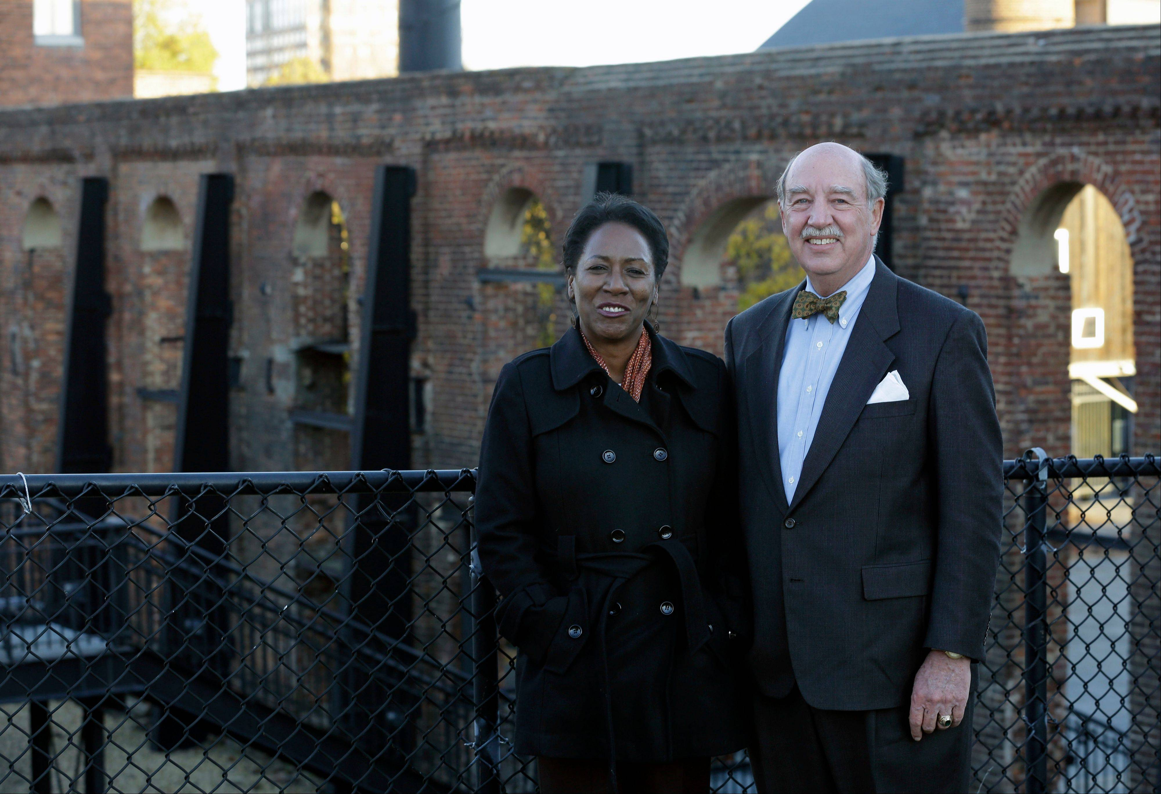 Christy Coleman, left, director of the American Civil War Center at Tredegar Iron Works, left, and Waite Rawls of the Museum of the Confederacy pose in front of the ruins of the old Tredegar Iron Works in Richmond, Va., Wednesday.