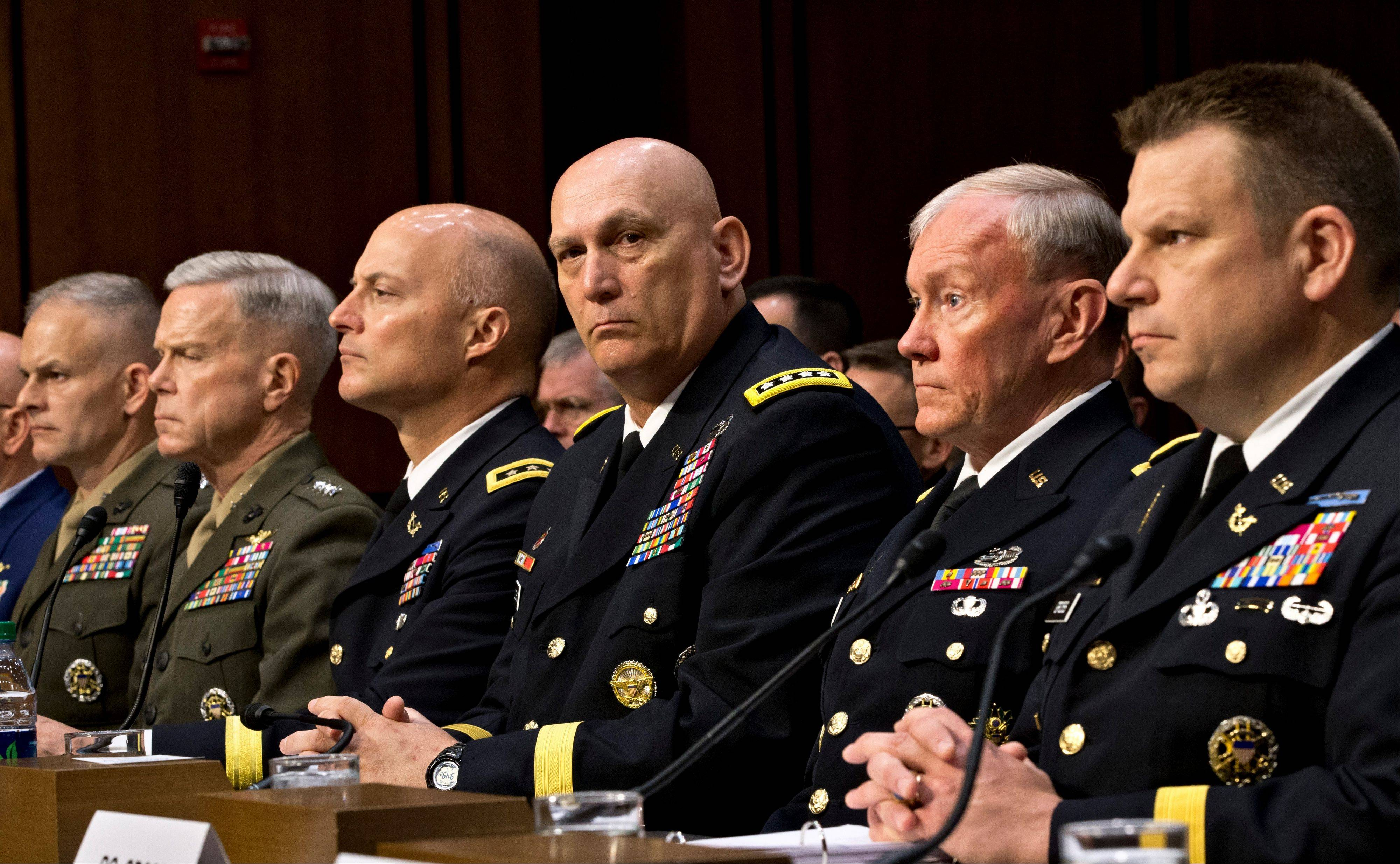 Military leaders, from right, legal counsel to the Chairman of the Joint Chiefs of Staff Brig. Gen. Richard C. Gross, Joint Chiefs Chairman Gen. Martin Dempsey, Army Chief of Staff Gen. Ray Odierno, Judge Advocate General of the Army Lt. Gen. Dana K. Chipman, Commandant of the Marine Corps Gen. James F. Amos, and Staff Judge Advocate to the Marine Corps Commandant Maj. Gen. Vaughn A. Ary testify at a Senate hearing on June 4.