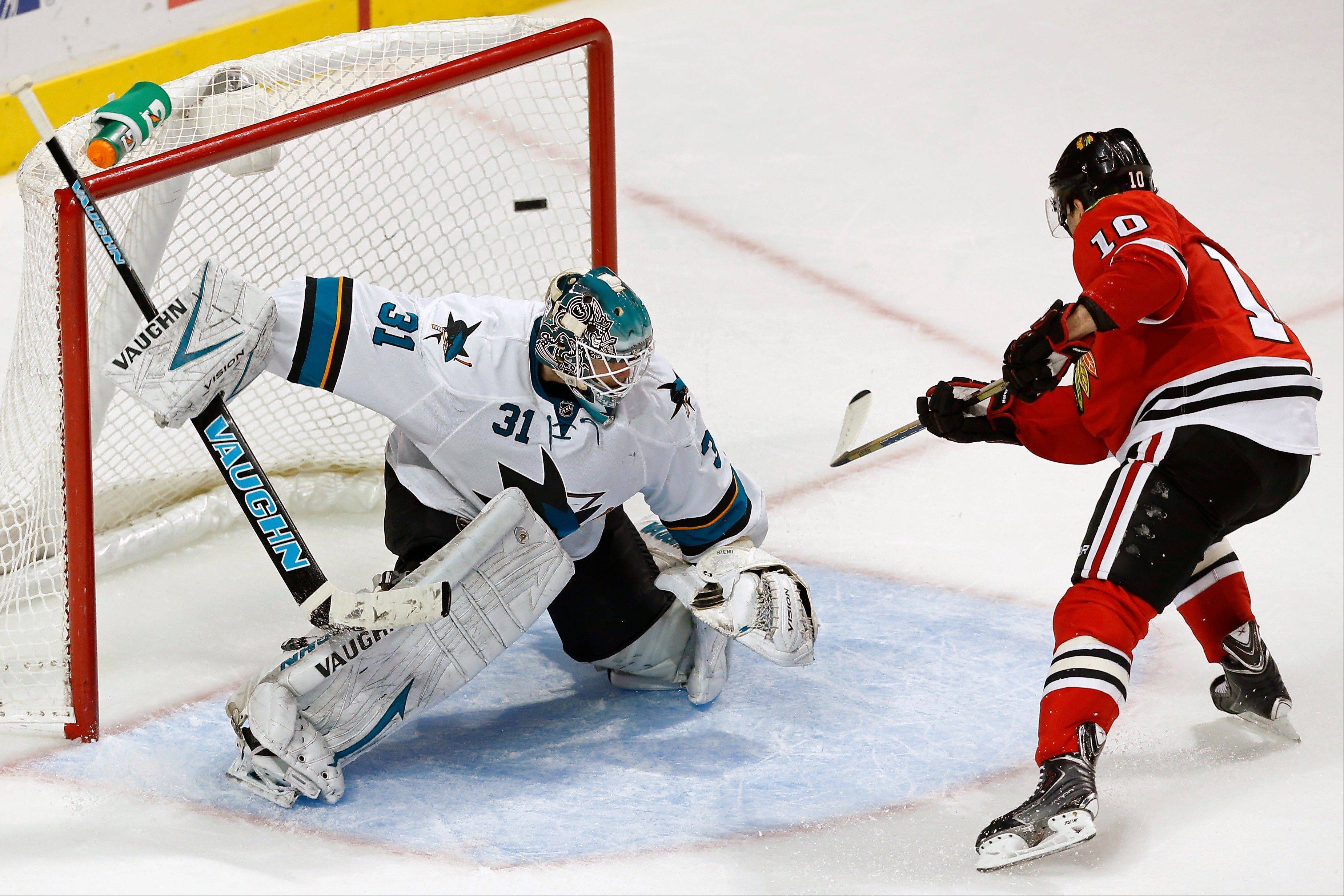 Patrick Sharp scores a goal past Sharks goalie Antti Niemi on a penalty shot during the third period of the Hawks� victory Sunday night.