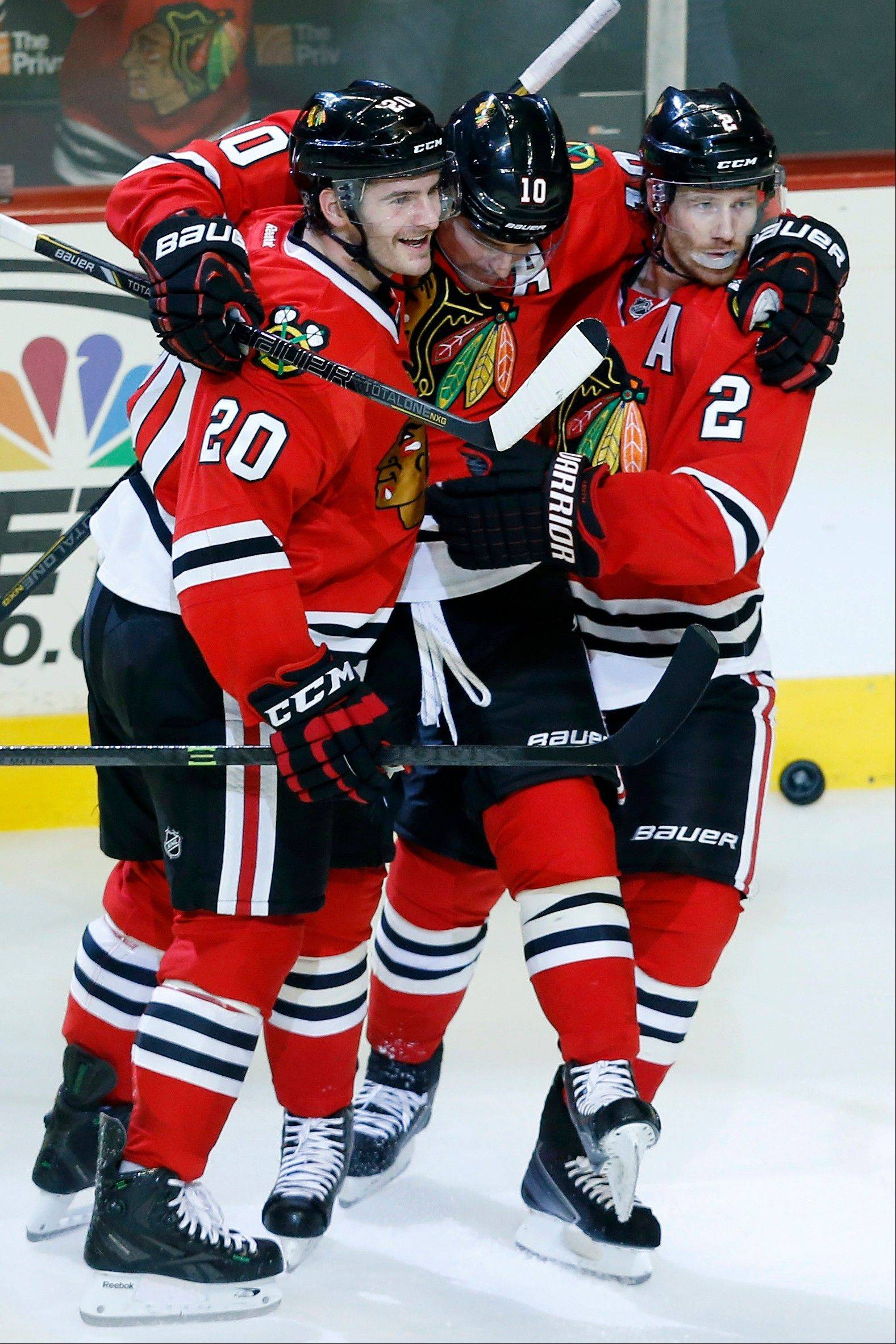 Blackhawks left wing Brandon Saad (20), left wing Patrick Sharp, center, and defenseman Duncan Keith (2) celebrate after Sharp scored a goal against the San Jose Sharks during Sunday�s second period at United Center.