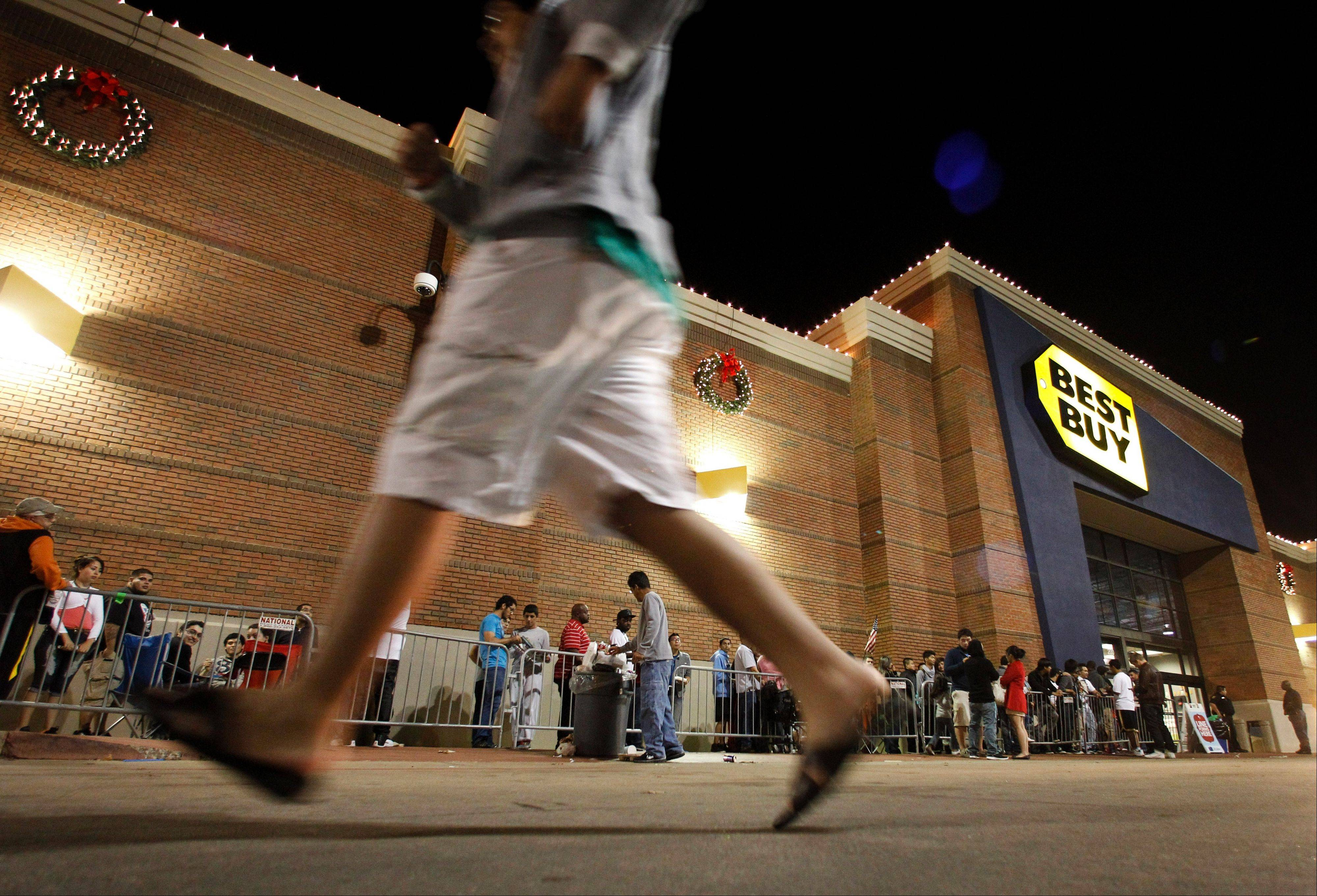 Shoppers stand in line outside a Best Buy department store before the store's opening at midnight. Thanksgiving is slowly becoming just another shopping day as at least a dozen major retailers are planing to open Thursday.