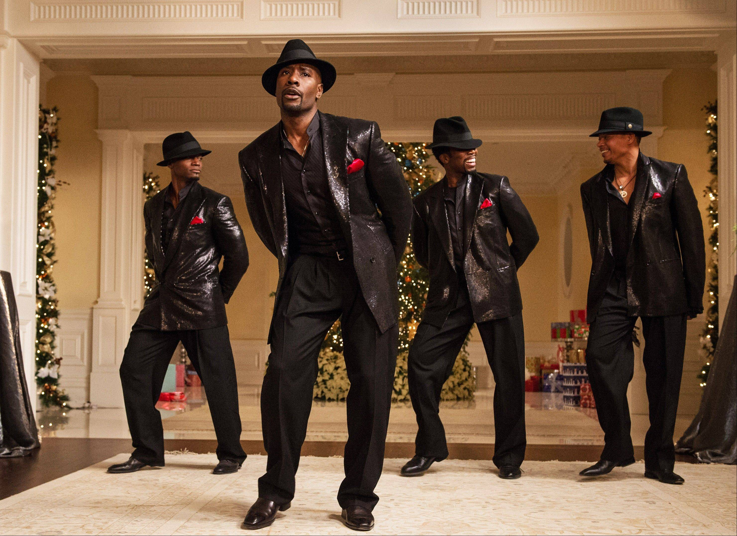 "This photo provided by NBCUniversal shows, from left, Taye Diggs as Harper, Morris Chestnut as Lance, Harold Perrineau as Julian, and Terrence Howard as Quentin, serenading the ladies in the film ""The Best Man Holiday."" The sequel garnered $30.6 million at the box office, almost beating out the blockbuster ""Thor"" sequel."