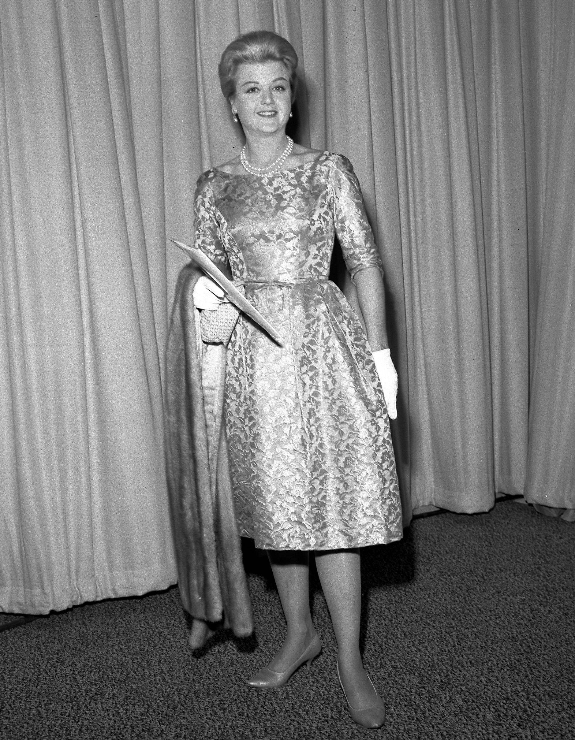 This 1961 photo released by the Academy of Motion Picture Arts and Sciences shows actress Angela Lansbury at the 34th Academy Awards ceremony, in Los Angeles. The Board of Governors of the Academy of Motion Picture Arts and Sciences will present Honorary Awards to Lansbury, Steve Martin and Piero Tosi, and the Jean Hersholt Humanitarian Award to Angelina Jolie. All four awards will be presented at the Academy's 5th Annual Governors Awards on Saturday, November 16, 2013, at the Ray Dolby Ballroom at the Hollywood & Highland Center in the Hollywood section of Los Angeles.