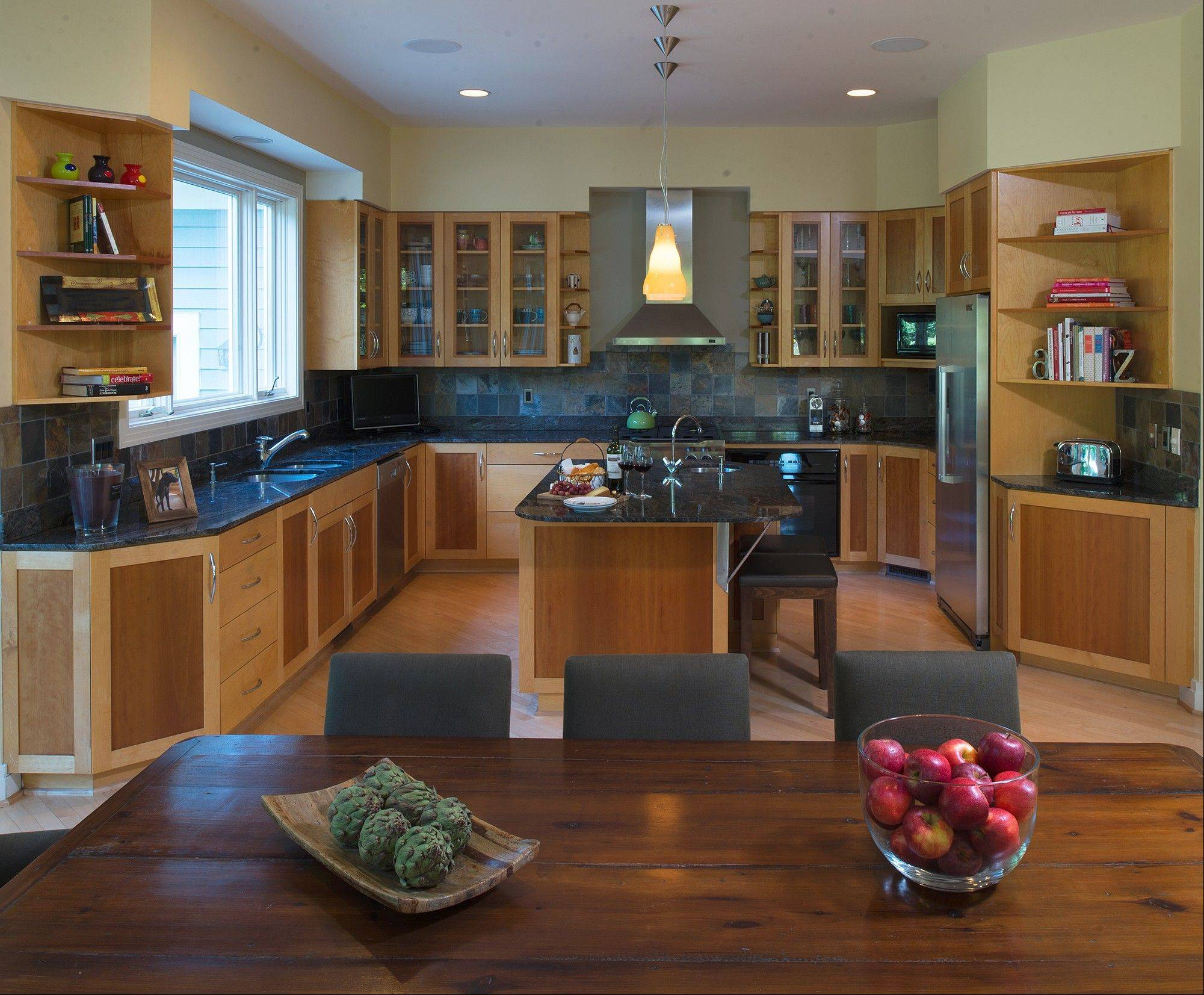 The Baker kitchen features dozens of maple cabinets with cherry veneer inserts and a center island with space for seating.