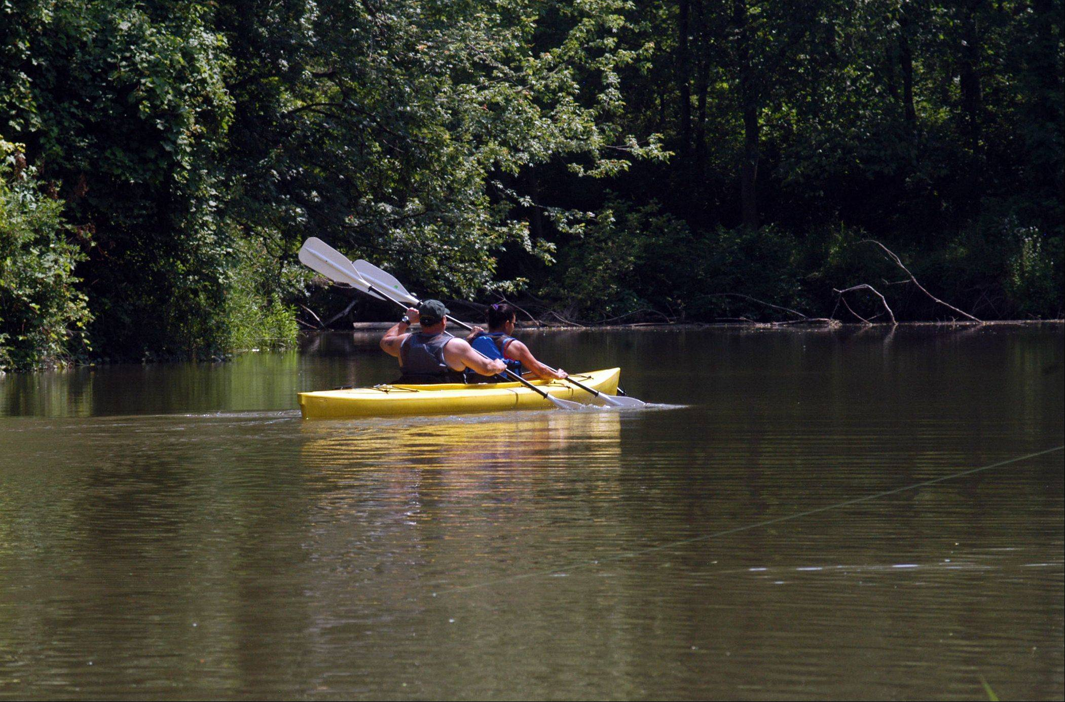 In warmer weather, visitors to Harbor Country in Michigan enjoy kayaking.