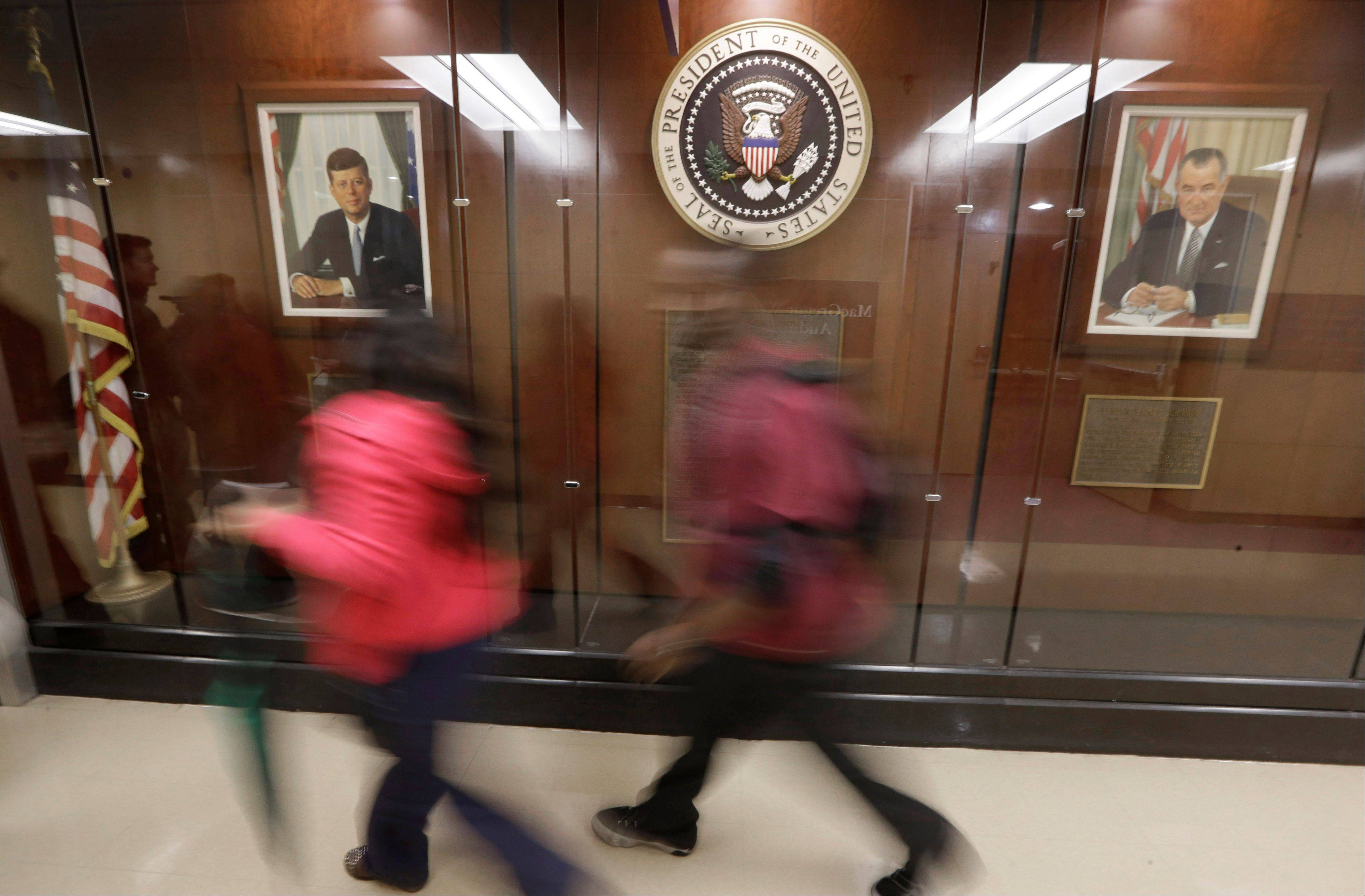 This hallway in Dallas' Parkland Memorial Hospital features a display that includes portraits of John F. Kennedy and Lyndon B. Johnson and the presidential seal.