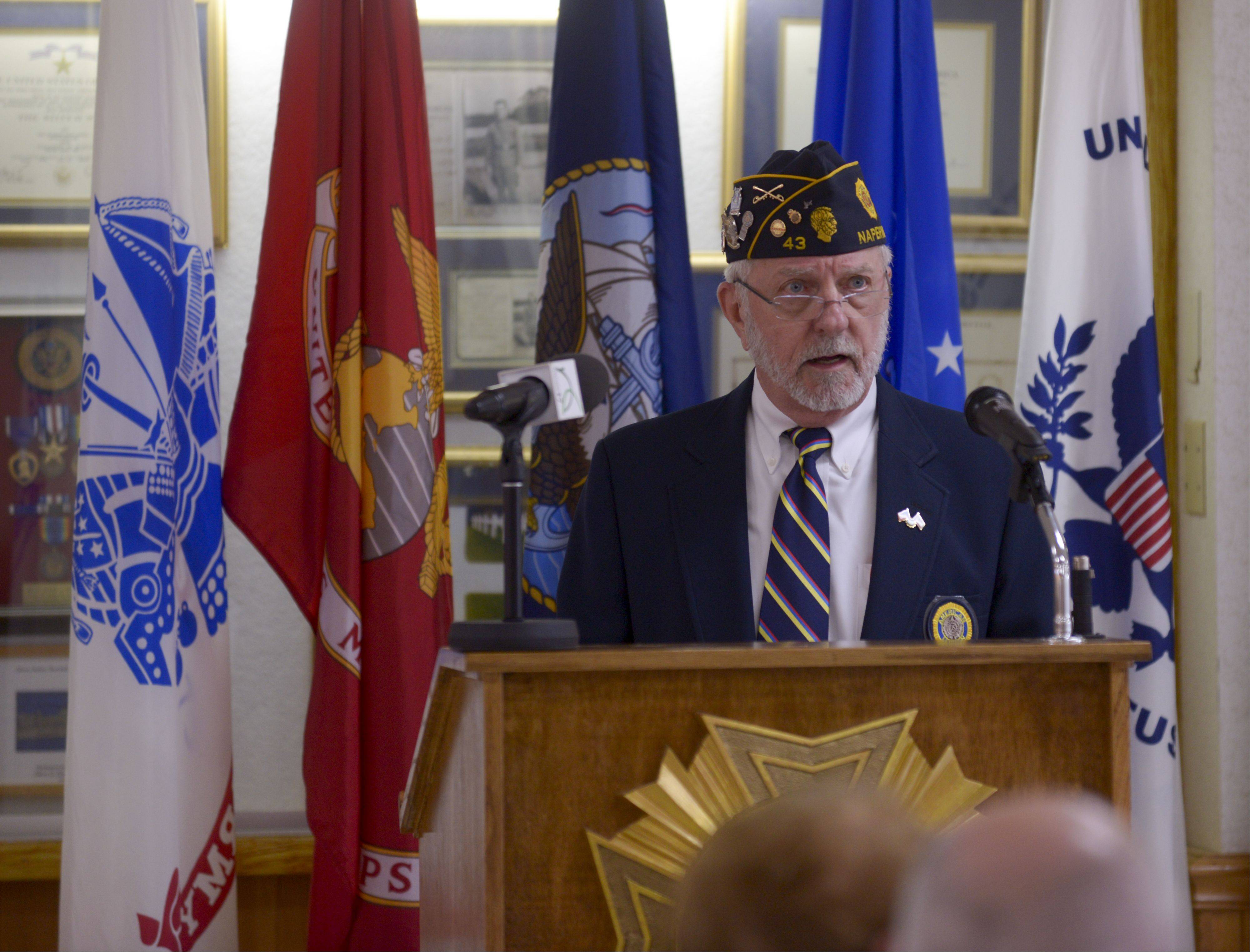 Jim Vahle of American Legion Post 43 acted as master of ceremony Sunday during the Blue Star Service Banners program that presented banners to families with loved ones serving in the armed forces.