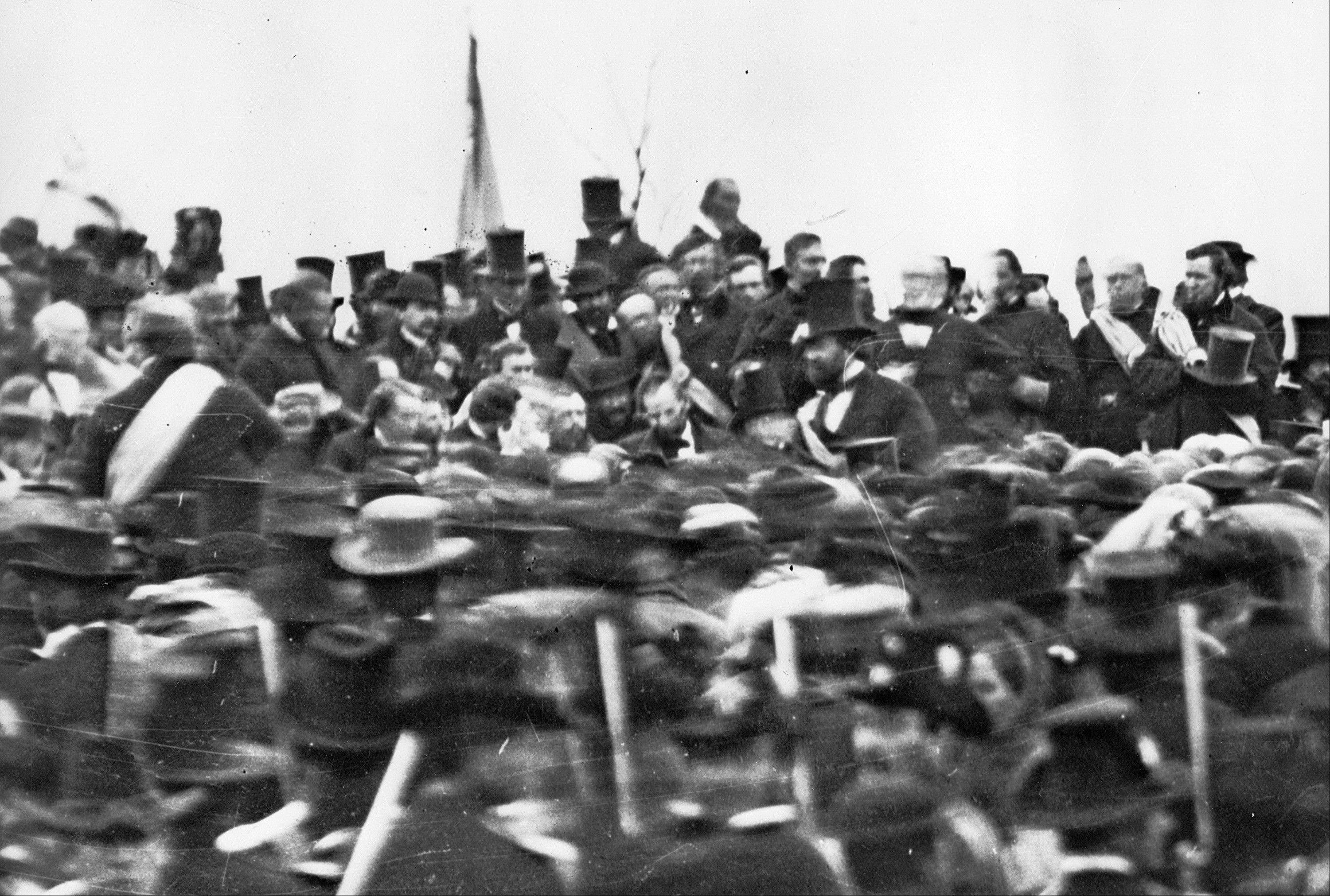 This Nov. 19, 1863, photo made available by the Library of Congress shows President Abraham Lincoln, center with no hat, surrounded by the crowd at the dedication of a portion of the battlefield at Gettysburg, Pa. as a national cemetery.