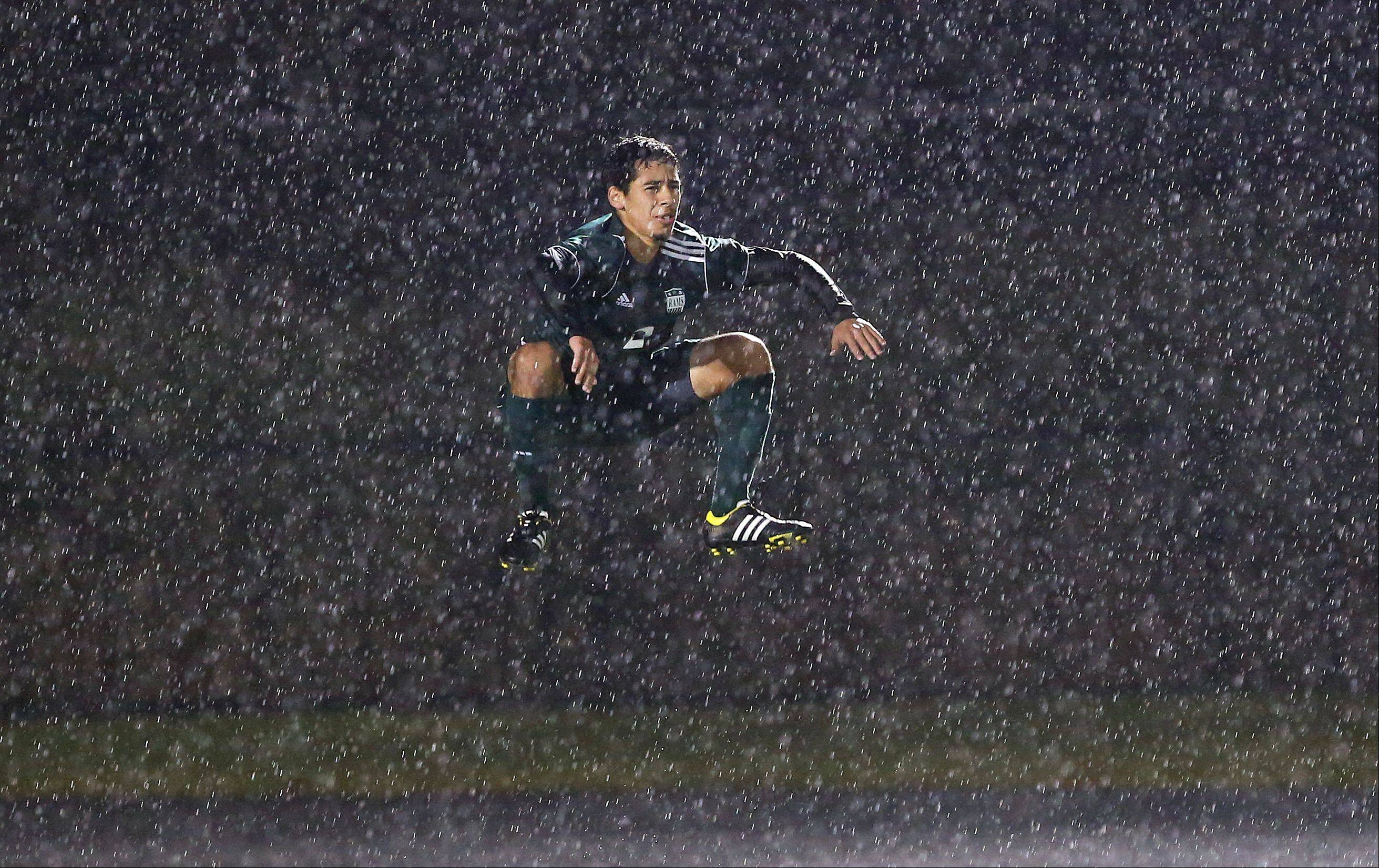 As photojournalists we have to be ready to shoot in any weather condition. This boys soccer matchup between Grayslake Central and Antioch took place in a total downpour. The dark background accentuates the rain as this defender from Grayslake Central tries to stay warm by jumping. This photo was published in the Perspective column in the print edtion.