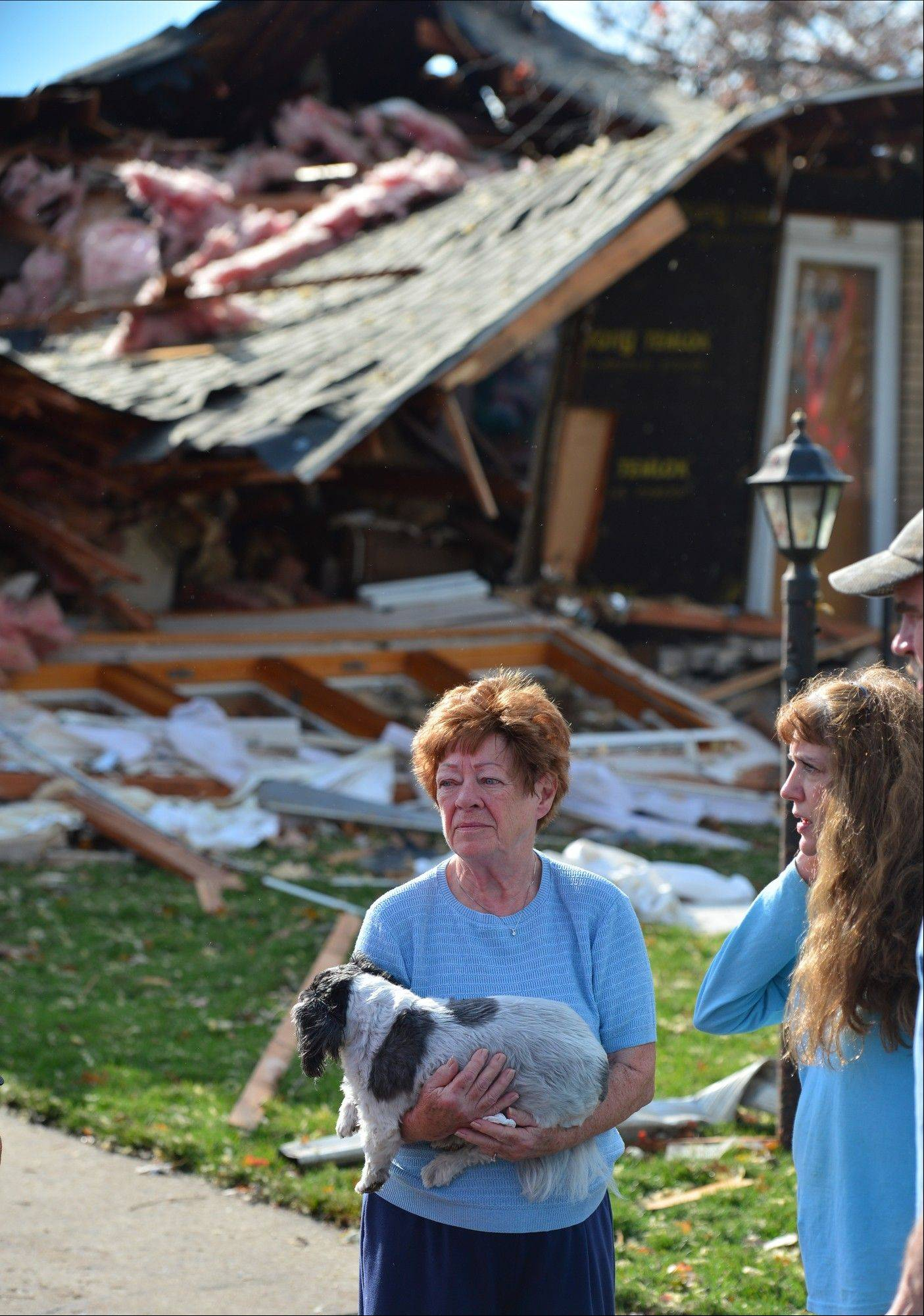 Shirley Wolf says she hung on to her dog Sammy for dear life as a tornado destroyed her home at 306 Delshire in Pekin, Il., Sunday, Nov. 17, 2013. Intense thunderstorms and tornadoes swept across the Midwest on Sunday, causing extensive damage in several central Illinois communities while sending people to their basements for shelter.