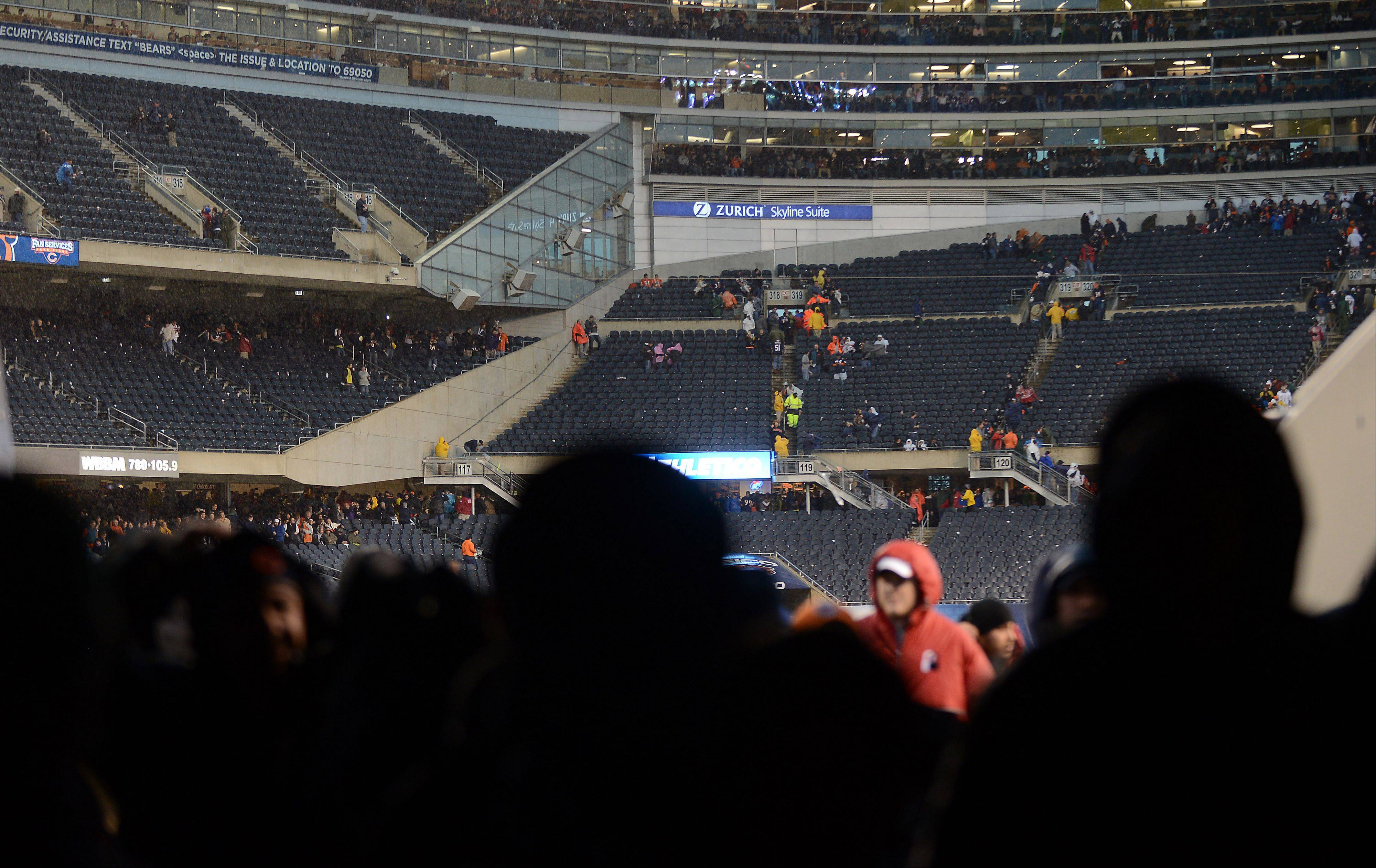 The stands empty and field personnel head through the tunnel as Sunday's Bears game is delayed in Chicago.