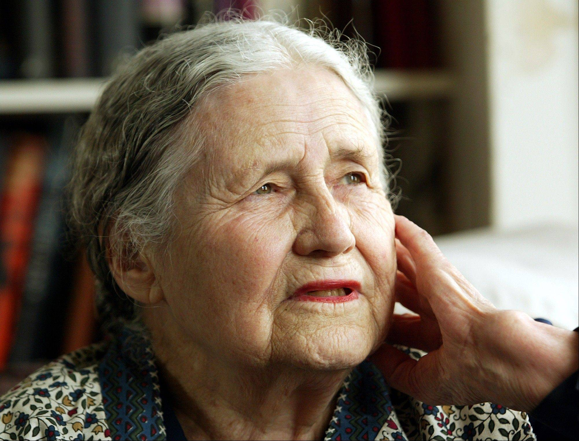 "In this April 17, 2006 file photo, Writer Doris Lessing, 86, sits in her home in north London. Doris Lessing, the free-thinking, world-traveling, often-polarizing writer of ""The Golden Notebook"" and dozens of other novels that reflected her own improbable journey across the former British empire, has died, early Sunday, Nov. 17, 2013. She was 94. The author of more than 50 works of fiction, nonfiction and poetry, Lessing explored topics ranging from colonial Africa to dystopian Britain, from the mystery of being female to the unknown worlds of science fiction."
