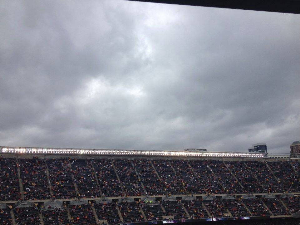 The Chicago Bears game was suspended nearly two hours Sunday because severe weather. Fans were ushered out of their seats into covered concourse areas.