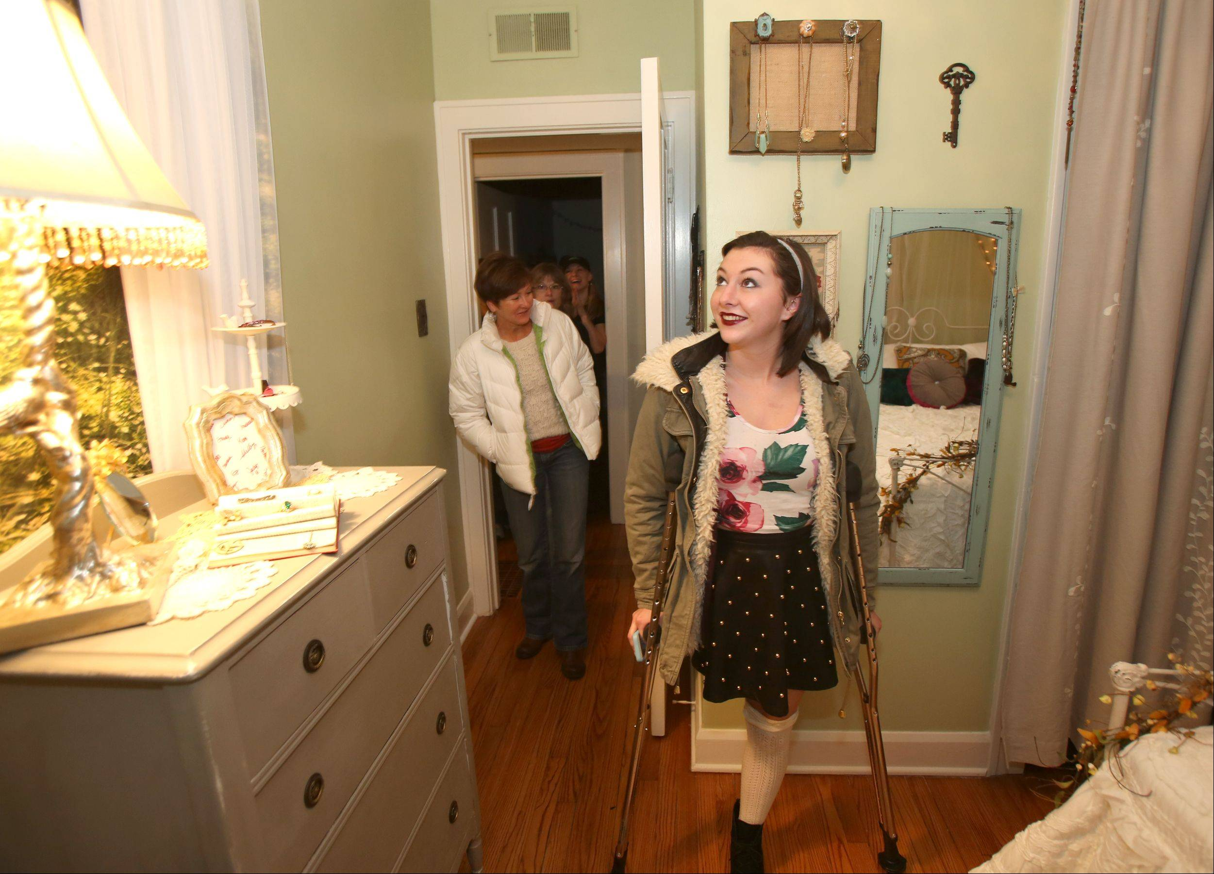 Genevieve Cipriano, 18, of Glen Ellyn looks over her bedroom, designed by Special Spaces Chicagoland, a Naperville nonprofit organization that creates dream bedrooms for children with life-threatening medical conditions.
